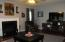 Great room with gas burning logs fireplace.