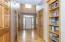Inviting Entry features hardwood flooring, 2-story ceiling, and built-in bookcase