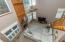 Great Room (19'7 x 14') features 2-story ceiling, gas log fireplace with decorative tile surround & wood mantle, built-in bookcase, ceiling fan, and staircase to Upper Level