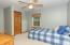 Bedroom #3 (11' x 14') features lighted ceiling fan, closet, and access to Full Bath