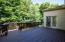 Spacious rear deck overlooking treed lot