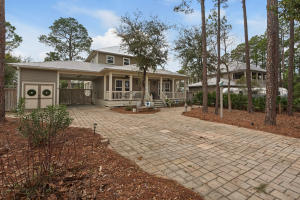 The driveway is large to maximize parking and flow. It blends in perfectly with the natural look and environment of the home.