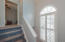 Stunning Arched Window in Stair Case Area