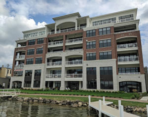 Property for sale at 128 W Wisconsin Ave Unit: Lake Level 1, Oconomowoc,  Wisconsin 53066