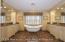 Granite countertop, classic bathtub, steam shower, radiant heat in floor, double sinks, custom vanities