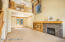 Beautiful gas fireplace.Gorgeous wood trim, case, base and bookcase