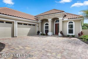 Stucco Home with Spanish Tile roof.
