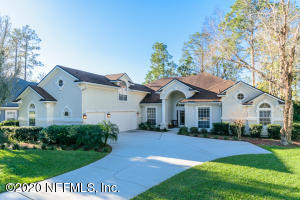 Front of home with 3 car garage, cul de sac location on the 3rd fairway.