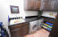 Excellent sized laundry room with lots of cabinetry