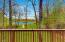 Deck outside the screen enclosed porch looks out to Fawn Lake