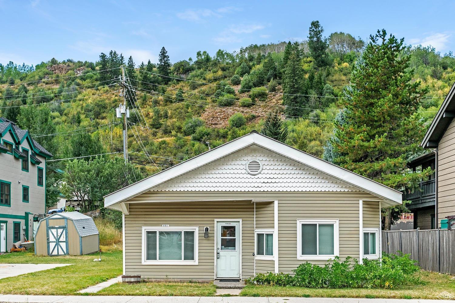 Premium location in the heart of Downtown Minturn, this 3 bedroom, 2 bath home on an oversized lot is zoned mixed use for commercial and residential and has incredible potential! Use it as a rental, redevelopment or move in & make your home in the quaint & desirable Town of Minturn. Situated with frontage on 2 streets, plenty of parking & storage, the home is just steps to the shops & restaurants, community garden, bus to Vail & the Eagle River. Call for information on development options.