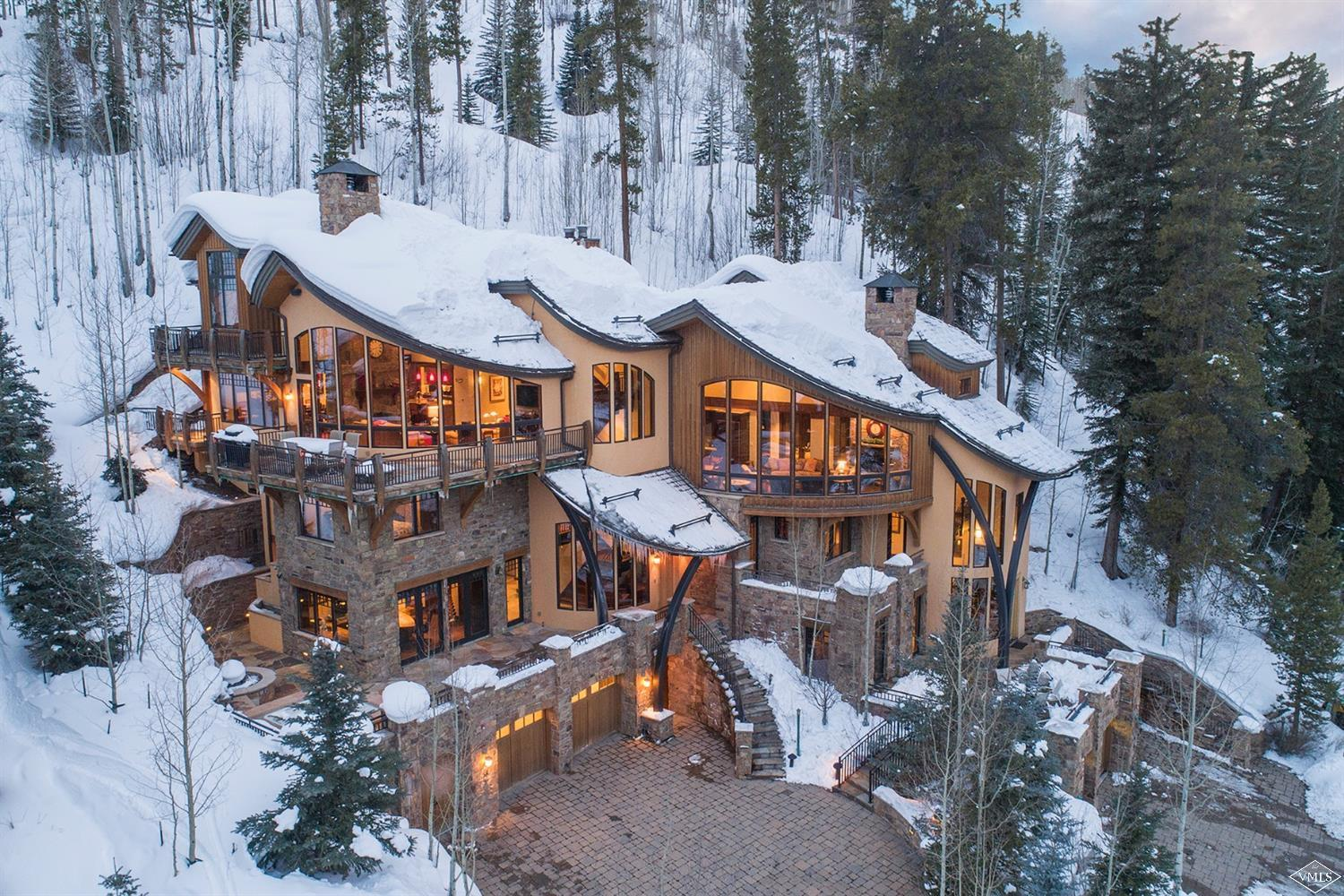 Located in the coveted Forest Road neighborhood, this home is steps away from the slopes, walking distance to Lionshead Village, and offers expansive views to the east looking towards Gore Range and Bald Mountain, generous natural light, and a high emphasis on privacy backing up to White River National Forest. 5-beds, 6-baths, media room, chef's kitchen, vaulted ceilings in the living room and master suite, ski storage room,and elevator. Both sides of duplex available for purchase.