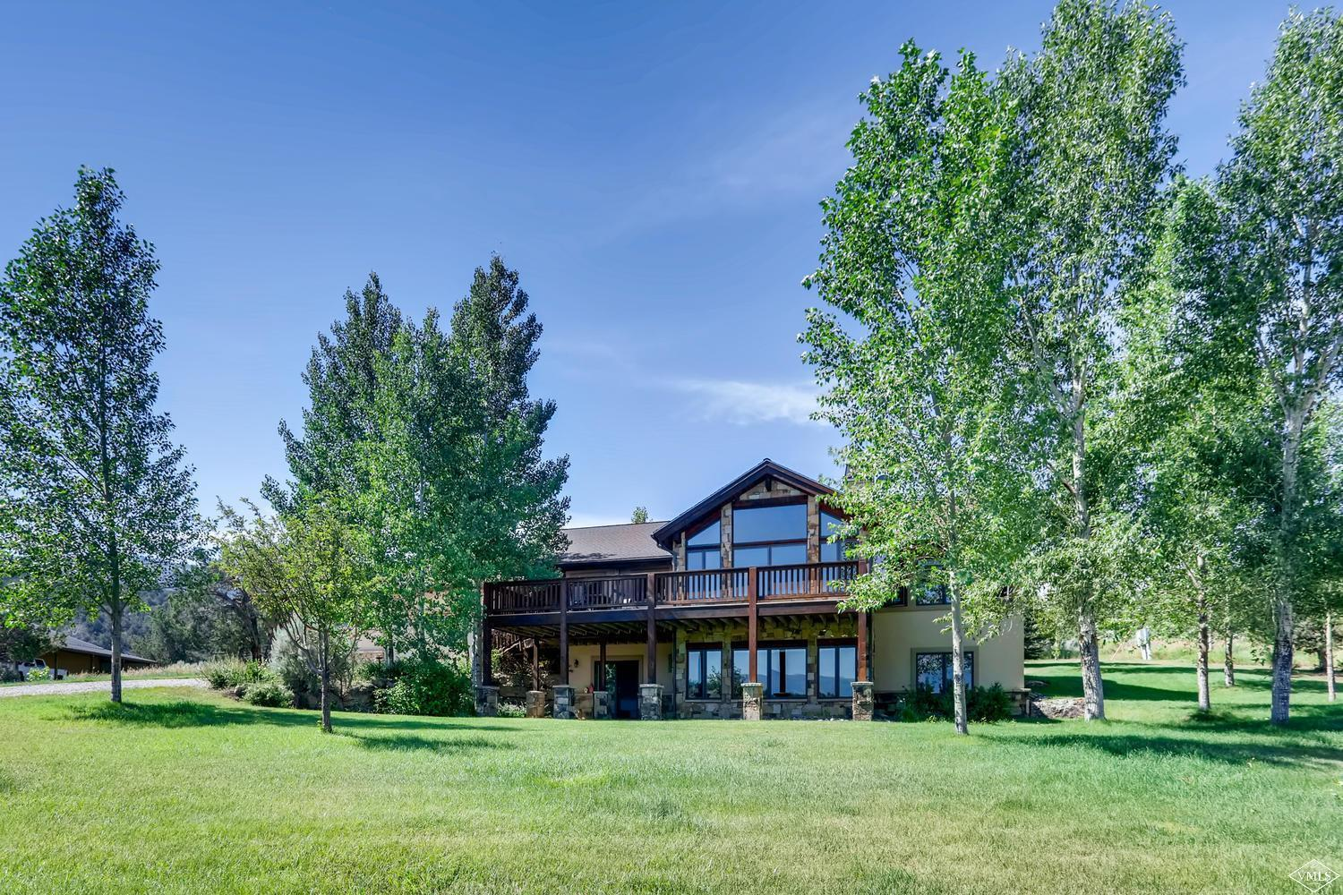 Rare offering with privacy and panoramic views with direct BLM and Forest access! Custom home on an exceptional 12-acre property with flat, fenced irrigated pastures. Features of the 4- bedroom, 3.5 bath home include high end finishes, an open floor plan, main floor master, walk out lower level, 3 car garage, large heated shop and deeded water rights. Conveniences of town are less than 5 minutes away, though you would never guess that with the privacy and peace this home provides.; Over 3 Car Garage; Live Water
