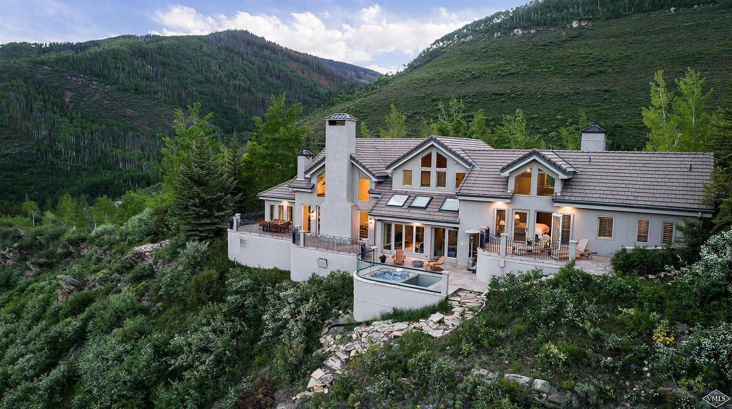 Top of the world views from this one of a kind home in the Buffehr Creek neighborhood. With a mountain modern design this residence has expansive 180-degree views of the Gore Range and Vail Mountain. The sunny open floor plan is ideal for entertaining with 3-fireplaces, gourmet kitchen, wine cellar and large great room. Exquisite landscaping and heated flagstone patio, 3-car garage and caretaker's suite/guest apartment.