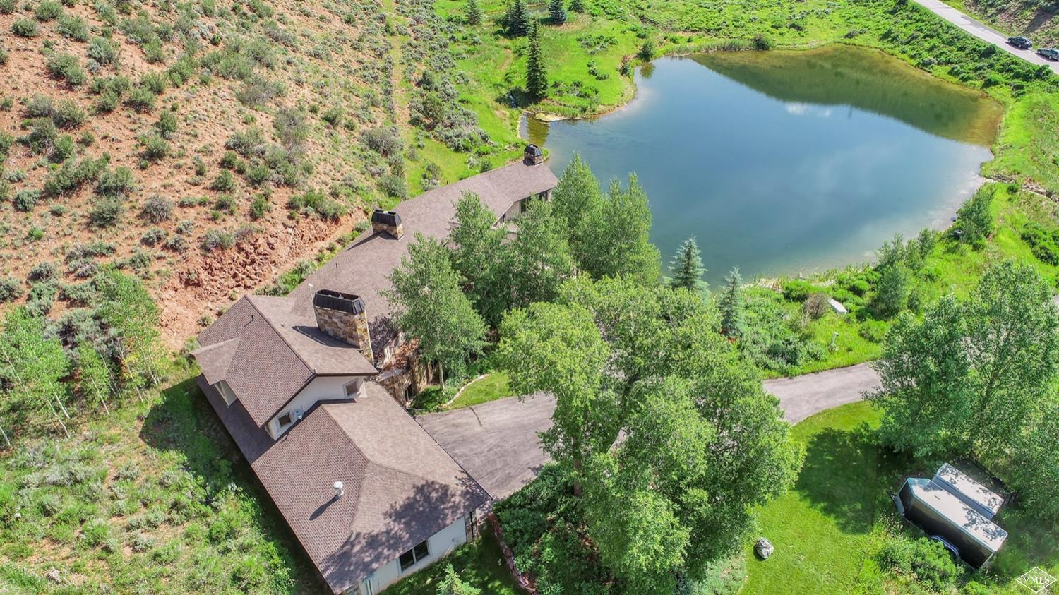 Unique rural setting with a huge Pond, Mature Landscaping, Waterfalls and Natural Beauty.Set on 37+ acres only a few minutes to Edwards. Lovely Colorado Craftsman 6 bdrm/6,1,1, bth w Many Custom Upgrades. Two Master Suites, 1 jr suite(or office), 6 fireplaces. Small 13 home HOA w low Taxes and Gated Community Entry. 3 car garage. Private Access to BLM Forest. Horses and Caretaker allowed. Resource zoned. An all season playground not to be missed!