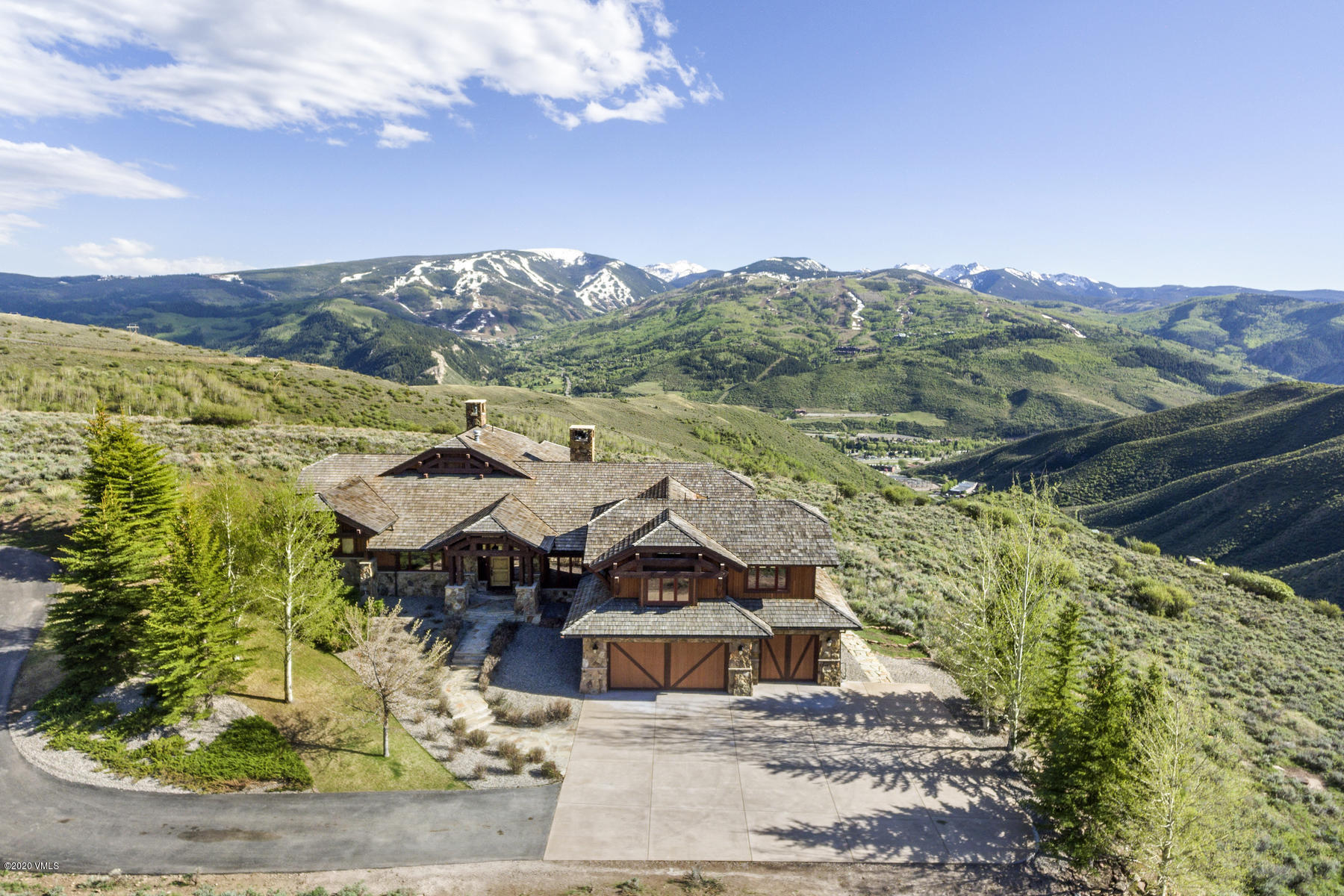 Nestled high on an alpine hillside with grandiose, unobstructed views of Beaver Creek, Bachelor Gulch, and the Sawatch mountain range, this 5-Bedroom, 7-Bathroom mountain retreat rests on 4.71 acres in the coveted Mountain Star community. Boasting its own private gate, this exceptional estate property welcomes you to a view that will take your breath away. A sensible and practical floor plan provides main-floor living with an expansive master suite, 5-piece master bath, a gourmet chef's kitchen and pantry, sizable office, great room, dining room, hearth room, and five fireplaces. Entertain guests with multiple living spaces, a wet bar, wine cellar, and two levels of outdoor living space. The upper deck provides for an intimate setting, while the patio space walks out to a flat and expansive yard, with stunning mountain views in all directions. Please visit mls.1305Wildwood.com for more photos and details.