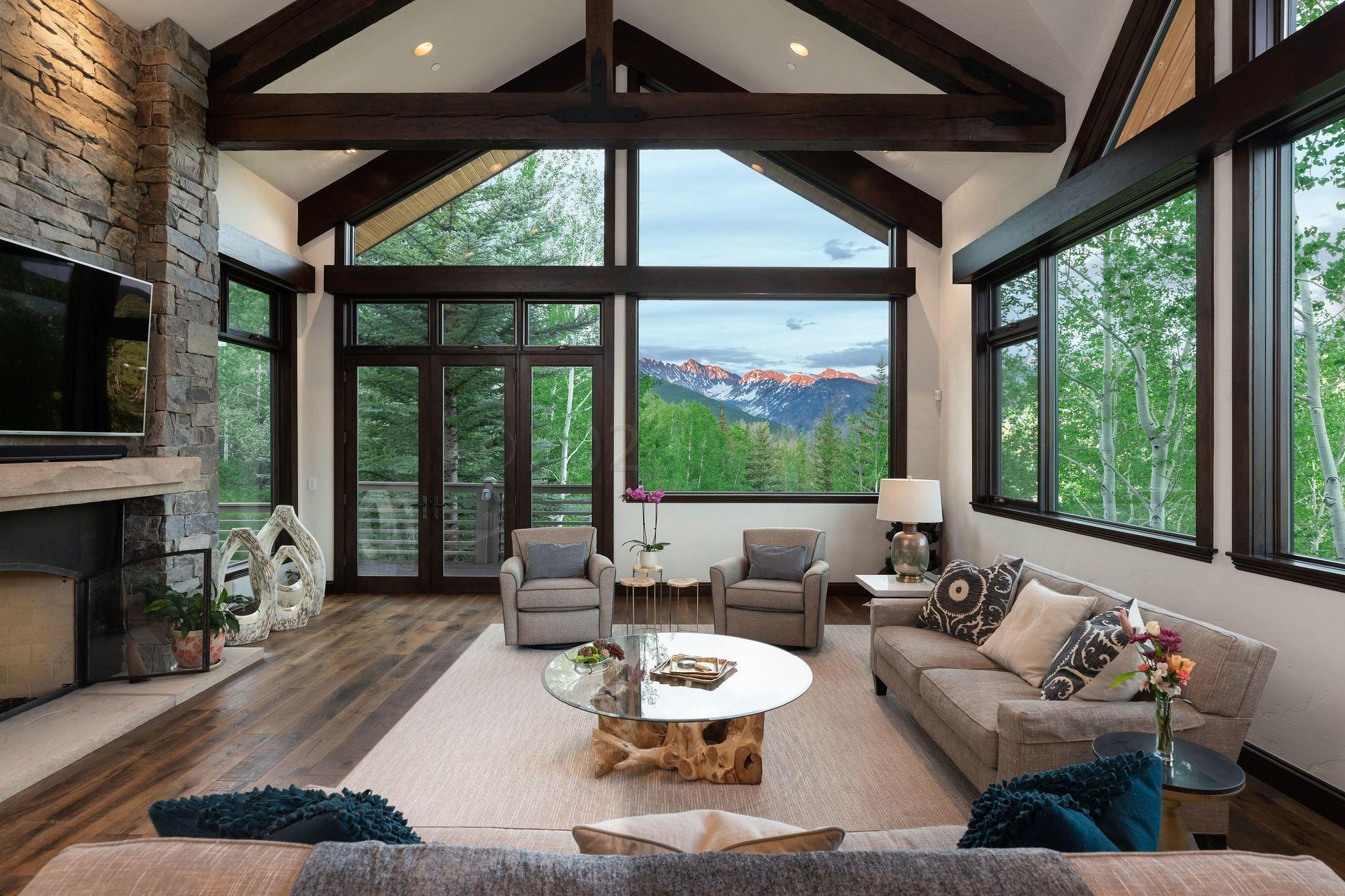 Seldom does a home of this magnitude, quality and character with an unparalleled location in Vail come to market. Freshly remodeled by Scott Turnipseed AIA, 1487 Buffehr Creek Road occupies one of the most unique 0.86 acre home sites in Eagle County. Surrounded on three sides by national forest land and endowed with ''in your face'' Gore Range and Vail to Beaver Creek ski mountain views with absolutely no I-70 impact. Extensive outdoor entertaining space with ample cascading water displays enhance absolute privacy amid spacious decks, yard area and rock gardens. Ascend a custom glass elevator to the main living level with open, flowing gourmet kitchen, dining and great room spaces surrounded by glass-encased views in all directions. You will not find another home with this extraordinary combination of features in Vail, Colorado. We look forward to introducing you to a spectacular home very few people have ever seen.