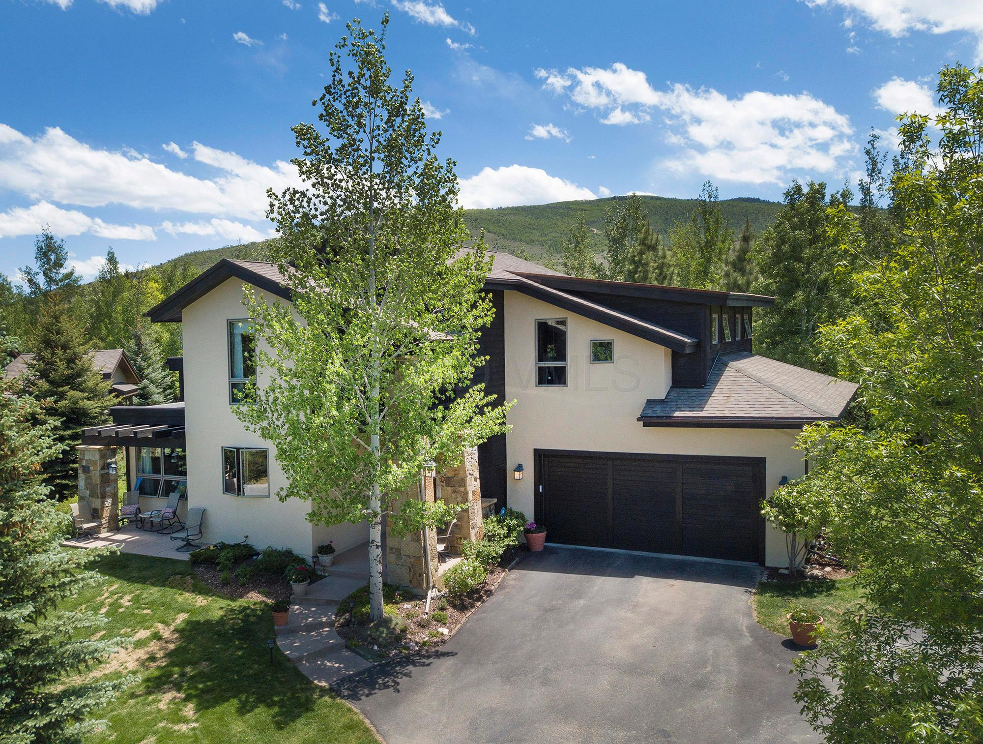 Craftsman style with mountain flair! This beautiful home is conveniently located in the quiet, secluded neighborhood of Heritage Park just minutes from the heart of the Vail Valley. Features include a main floor master, oversized, heated, 2-car garage, a warm, open floor plan connecting the kitchen, living room and dining room, a private deck with hot tub, and a separate entertainment room on the lower level for the kids. This home also backs up to an open space park maintained by the HOA. Amazing home for families or entertaining! A home designed to accommodate  an active lifestyle.
