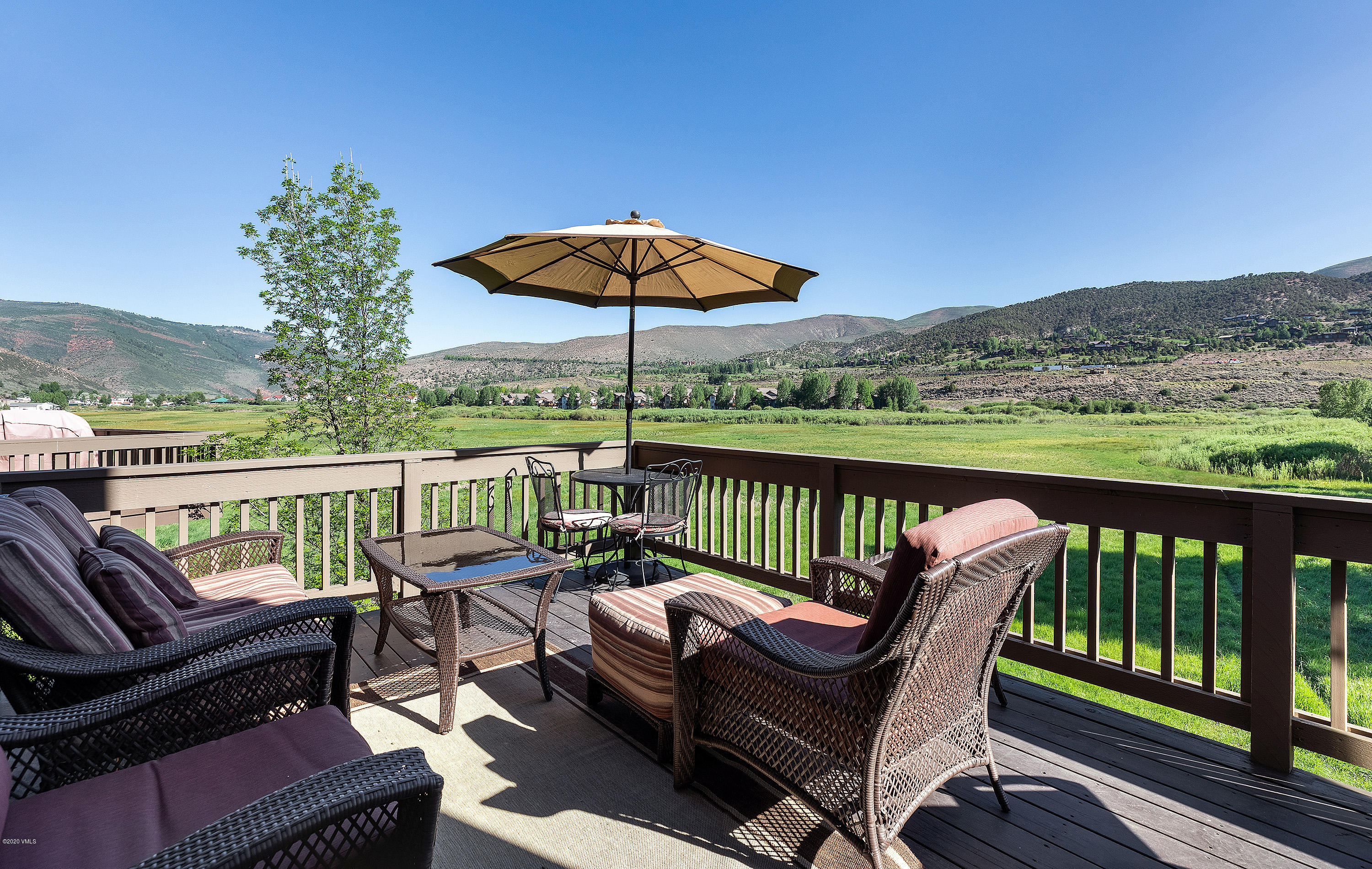Overlooking a vast open wetland meadow with wildlife and mountain views beyond, this beautiful Edwards home is located on the confluence of Lake Creek and the Eagle River, with private fishing rights just outside the back door.  The home is filled with natural light and features elegant finishes, hardwood floors, and plush carpeting.  The main floor open-concept living room leads to the deck for lounging and enjoying stunning sunsets. The adjoining kitchen and dining area boast alder cabinetry and granite countertops. A nearby ''ski closet'' provides cubbies for boots and helmets or other storage needs.  Relax in the spacious lower level recreation room leading to the enlarged patio with a rock garden and grass yard for play or for hammock time.  In the winter step outside for cross country skiing in the backyard meadow.  Five roomy en-suite bedrooms, three on the top floor and two on the lower level, provide personal space for everyone.  This fabulous home is ideally located, a quick walk to restaurants, the movie theater, and shopping in Riverwalk. Inquire about an option for the Arrowhead Alpine Club membership with free parking, spa services, a pool, and social activities.  Cross over the nearby bridge to the east of the home to discover a children's play set and covered picnic tables by the beautiful creek.  This home is a wonderful setting for enjoying life in all the Vail Valley has to offer.
