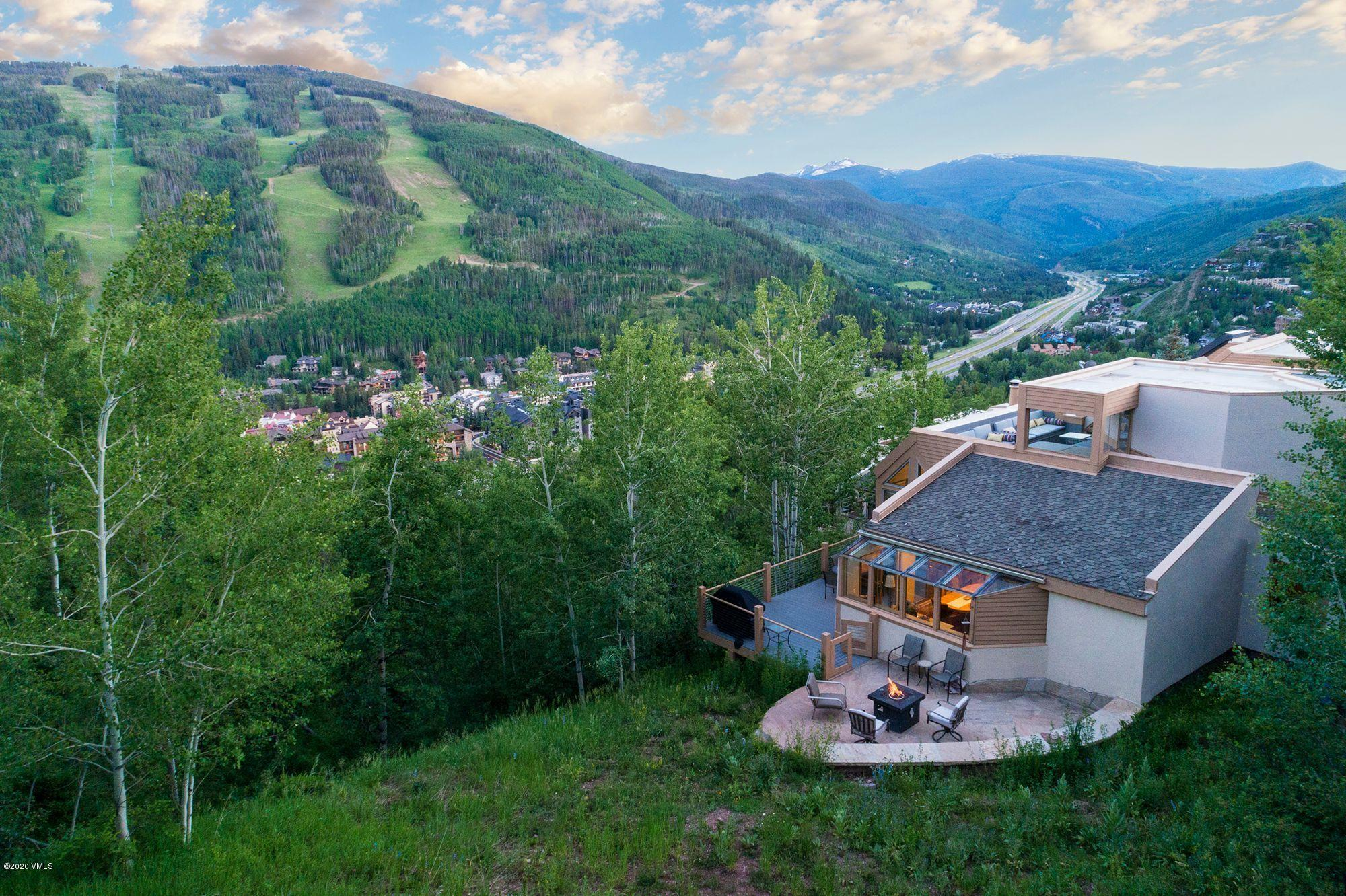 Unbelievable VIEWS of Vail, Holy Cross and Beaver Creek from this end unit. Enjoy the company of wildlife from the kitchen, dining room, deck, and recently added patio with fire pit. BEST end unit location in complex of 17 units. SUNNY lot, south east exposure with an abundance of windows and light! Immaculate views from EVERY bedroom, including stunning expansive views of the whole front side of Vail from the master bathroom. Inviting rooftop hot tub and deck with ample comfy seating to wind down after a day of skiing or hiking. This condo ownership feels and lives like a single family home being on the end. Very RARE FIND!!Upgrades include: New patio with fire pit on the east end of the unit. New TREX decking off the dining room which has doubled the space. New TREX decking on the top level with a NEW hot tub, along with customized cushions and new build-in seating by hot tub. New carpet, paint and additional water heater. New double ovens in kitchen. Added the shades in the living room and master bedroom with upper shades on remote. Replaced the storm and screen door at the front entrance. New mattress and box spring in master.Please note:Unit is rented on and off through September 19th 2020 and the Buyers must honor those rentals in place.