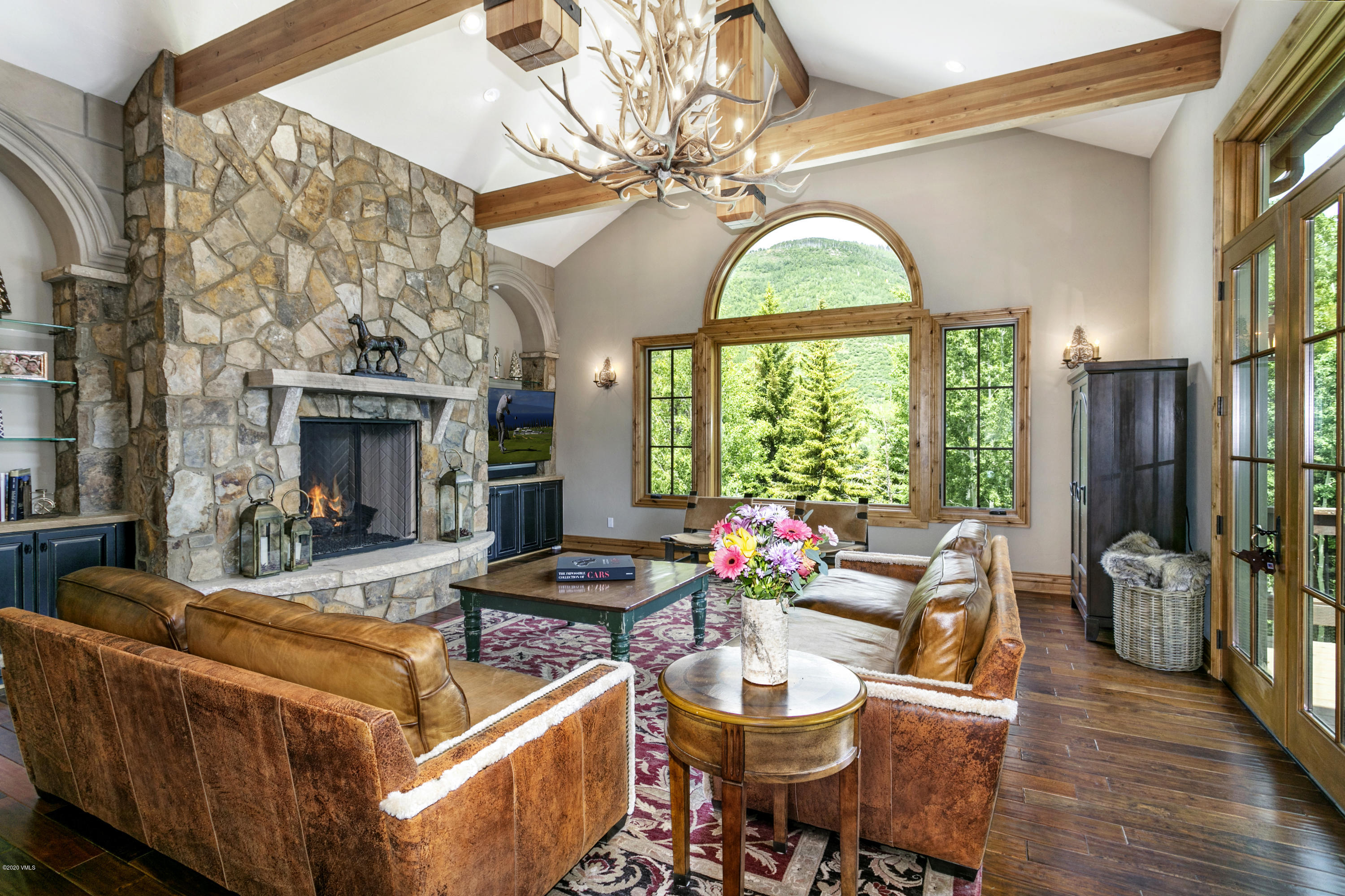 A stately masterpiece on a premier homesite in the heart of vibrant Vail, Colorado!  Classic Alpine style and meticulous detail in a pristine setting create a home in which you will be as proud to entertain as you are comfortable to reside.  This exceptional location offers the serenity, the wildlife, and the pristine mountain setting of a home built deep in the Colorado Rockies, yet it is merely minutes from the world class skiing, shopping, dining and more.----------   This perfect primary residence or weekend escape is classically and impeccably designed, with sweeping views of the endless adventure that abounds.  Luxury features include timeless feel with 6-bedrooms, family room, wine cellar, air-conditioning, elevator and 2-car garage. Live your best life now. ----------Discover Vail, Colorado and explore the charm of this luxury alpine escape with overwhelming natural beauty which presents an incomparable venue for mountain living, year-round recreation and cherished family tradition.