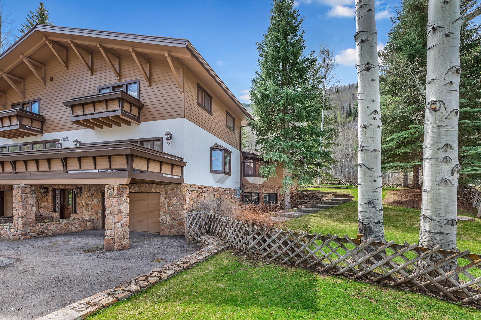Endless opportunities await for this Vail Golf Course property! Backing up to the National Forest, the new owner can add additional square feet and take advantage of the fairly flat lot. Walk, bike or take the TOV bus into Vail Village.