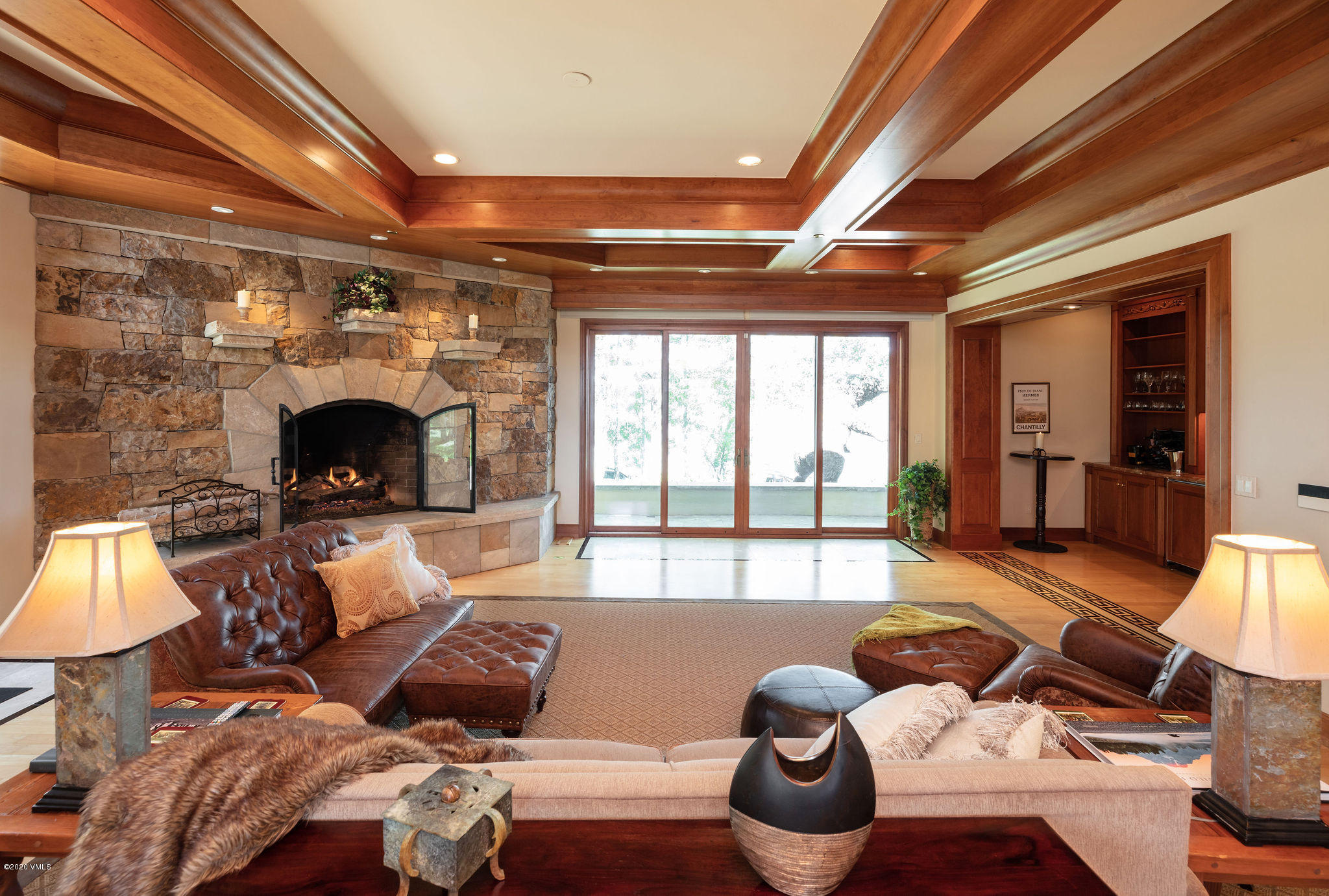 Located within the gates of the Divide at Cordillera, this spectacular custom home is set beautifully on a 2-acre homesite with unobstructed and breathtaking views of the entire Gore Range.  The residence offers one-of-a-kind finishes and fine details including coffered ceilings, custom hardwood flooring inlays, interior stone columns, spacious double offices with fine wood built-ins, and his and hers master baths and closets.  Four guests suites are found on the upper floor, accessible by elevator which services all three levels.  Floor to ceiling windows on the main level bring in the morning sun and views of the enormous back yard overlooking the entire upper Vail Valley. Surrounded by lush landscaping and stone patios, the home provides the space you need and the comfort you want, both inside and out. There are several outdoor seating and gathering areas, a fire pit area with a separate stone patio, and a one-bedroom apartment on the lower level with its own private patio and grilling station.  All areas of the home are fortunate to encompass the perfect views of the majestic Gore Range.  Perfect for the current buyer looking for a family refuge with plenty of space for work, play, at-home schooling, extended family, outdoor spaces and privacy.