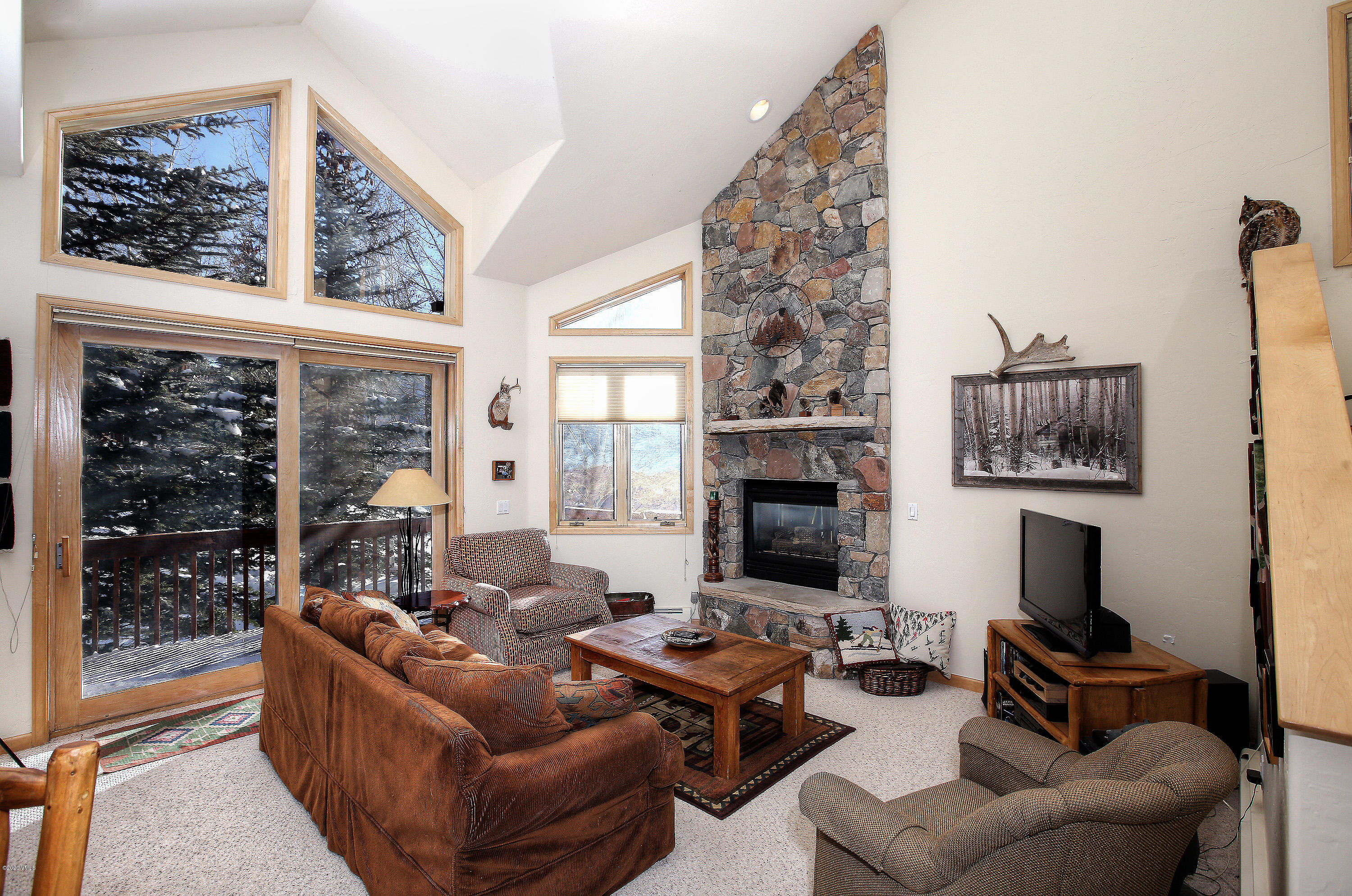 Rarely available well maintained Chateau Tremonte townhome. This light and bright end unit offers mountain views with a comfortable open floor plan, vaulted ceilings along with 3 spacious bedrooms, 3.5 baths, a heated two car garage, 2 decks and a large laundry room. Conveniently located close to shops and on the Town of Vail bus line. A must see!