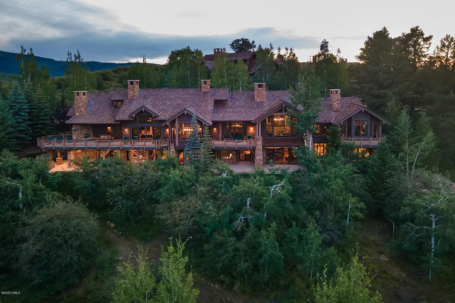 Designed to complement the splendor of its natural surroundings, this property is mountaintop luxury crafted in the historic tradition of the nation's grand lodges. This home features no less than 10 fireplaces on two levels, and awe-inspiring panoramic east-facing views throughout the main level. Soak in a breathtaking alpenglow scene that spans from the top of Beaver Creek Mountain across Vail's Game Creek Bowl and beyond to the knife-edged jags of the legendary Gore Range.Tucked away in the mature alpine landscape, this exquisite home provides year-round enjoyment of the vast recreation just outside the door. Winter months offer ski-in/ski-out access to the Bachelor Gulch chairlift via the Everkrisp and Ridge Rider private homeowner ski-ways that weave in and out of this exclusive on-mountain community. And, temperate summer months display a colorful sea of wildflowers, easily accessible with the Village-to-Village hiking and mountain biking trail nearby. 168PeakView.com/?mls