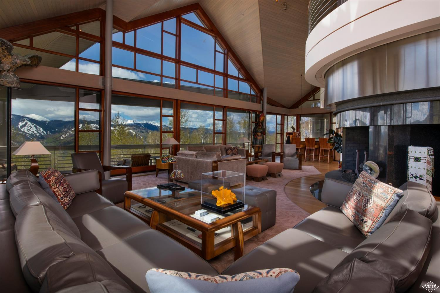 Opportunity to own one of the finest mountain contemporary homes ever built in the Vail Valley. Located in a serene, private setting in this exclusive gated neighborhood adjacent to USFS, this property is an estate of its own offering phenomenal mountain views. Renowned architect, Robert Ziegelman, designed this residence to blend harmoniously with the natural landscape and provide superior living spaces in 3 separate pavilions all with exceptional quality/amazing design. Designer furnished.