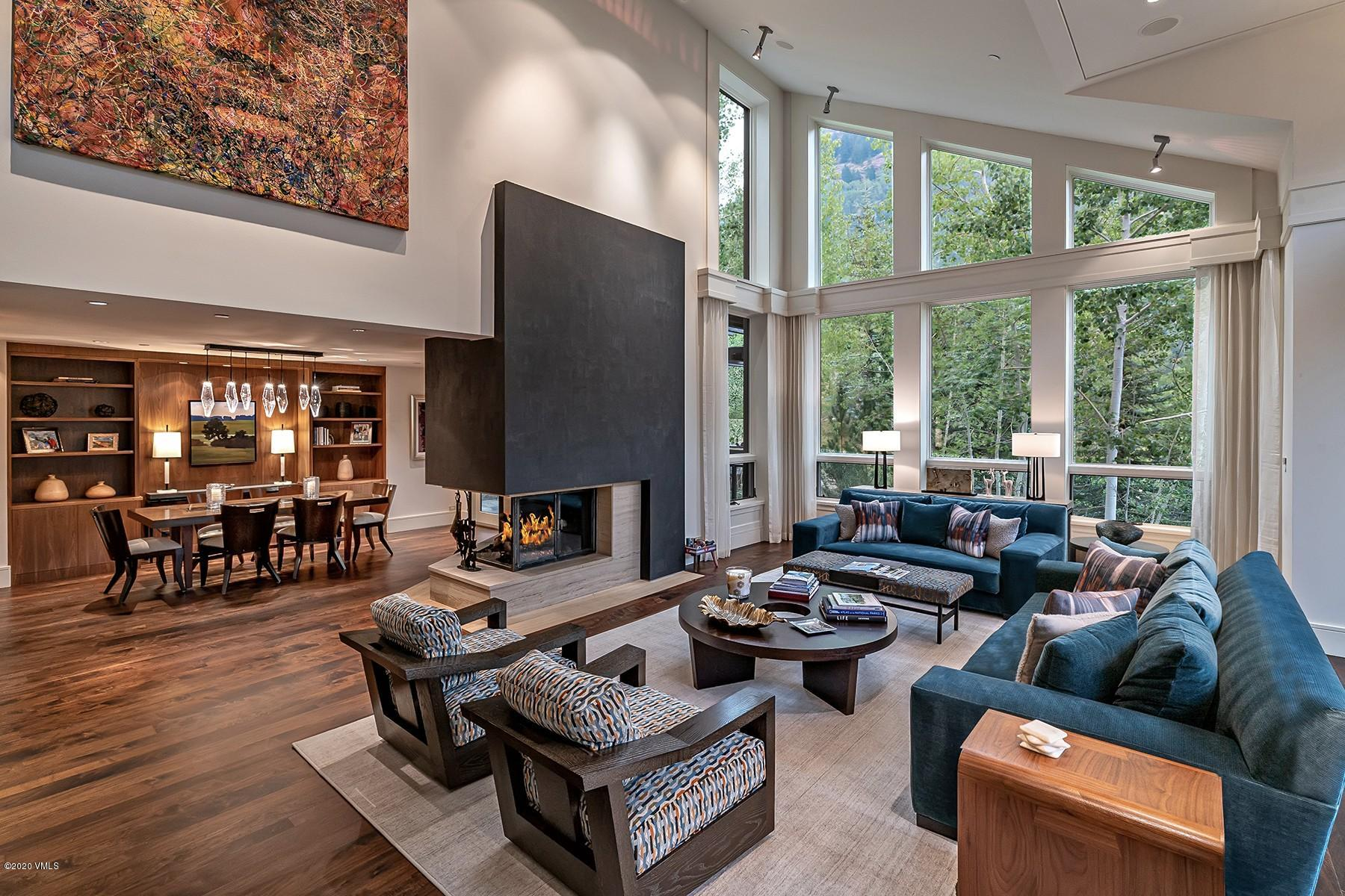 Tucked away amongst the quintessential alpine environment this south-facing mountain contemporary dream home provides an abundance of sunshine throughout the day. Dramatic floor to ceiling windows seamlessly breathe nature into this eloquent floor plan which has been fully designed to entertain a lot of family & friends. Multiple outdoor living spaces. Elevator and hot tub. Owner installed a new roof and all new mechanical system in 2019. Visit 2975mannsranch.com/?mls to learn more.