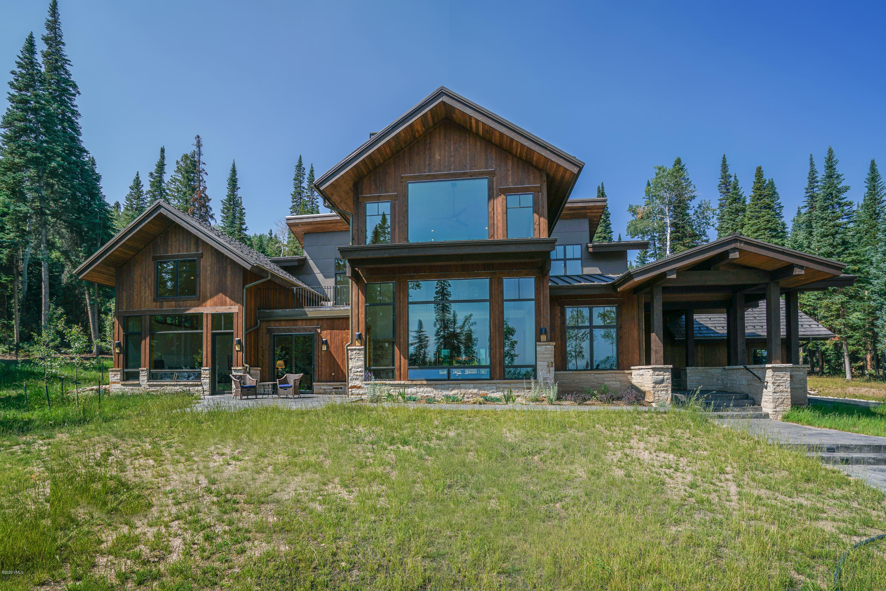Spectacular new construction in Cordillera Summit showcasing unobstructed views of the Gore Range and Knee Knocker Pass. Enjoy superior privacy on this wooded lot surrounded by tall subalpine firs and aspens in a gated community with the Cordillera pond across the way.  Under 4,500 square feet in Cordillera, this home was just completed July 2019 by builder, Concept 30 LLC, Bernie Weber Contractor and RAL Architecture, Bobby Ladd Architect. With a high level of attention to detail, it is the perfect mountain contemporary blend with a timeless design. Featuring alder wood trim, walnut cabinetry, vaulted ceilings, and white oak floors throughout, this home was masterfully crafted with high quality materials and finishes. Soak in the stunning Vail Valley landscape from the huge windows in the great room in front of the stone gas fireplace.This open concept floor plan was thoughtfully designed with the living room flowing to the kitchen and dining room with sliding glass doors opening up to the outdoor patio and fire pit. The large back patio is the ideal mountain setting to gather and entertain, with quick accessibility to the kitchen and the front patio shows off mature trees framing gorgeous Gore Range views. Additionally, the back patio is wired for a hot tub and is plumbed for a gas grill. Top of the line appliances include a Wolf gas cooktop, double-oven, & microwave, a Sub-Zero refrigerator, ASKO dishwasher, and a U-Line under counter beverage refrigerator & wine refrigerator. Also on the main-level, is the master bedroom suite with its own walk-out patio and steam shower in the master bath, as well as two well-equipped offices (one could easily be used as a bedroom). The second level features three spacious bedrooms all with en-suite bathrooms, a second laundry room, a loft sitting area with a wet bar, and a deck overlooking the pristine property and mountain vistas. Lastly, the garage is wired for an electric charging station. For those seeking a new mountain m
