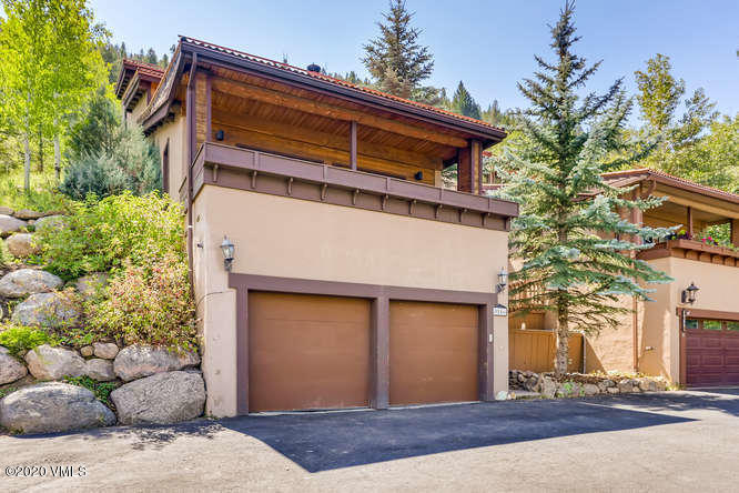 Located high on the hill in EagleVail, this 3 bedroom, 3.5 bath home backs up to Holy Cross Wildness area for exceptional hiking and views.  All bedrooms have ensuite bathrooms and have their own patio or deck.   Additional new trex deck off the living room allows you to enjoy the outdoors and the views of the Vail Valley.  Bathrooms and kitchen were remodeled several years ago along with beautiful hickory wood floors. 1 Wood burning fireplace and 3 gas stoves provide warmth and ambience to the rooms. This is an excellent opportunity for an investor or the person wanting to purchase at a great price and add their own tender loving care to this home on the hill to make it shine!Complete with 2 car garage.