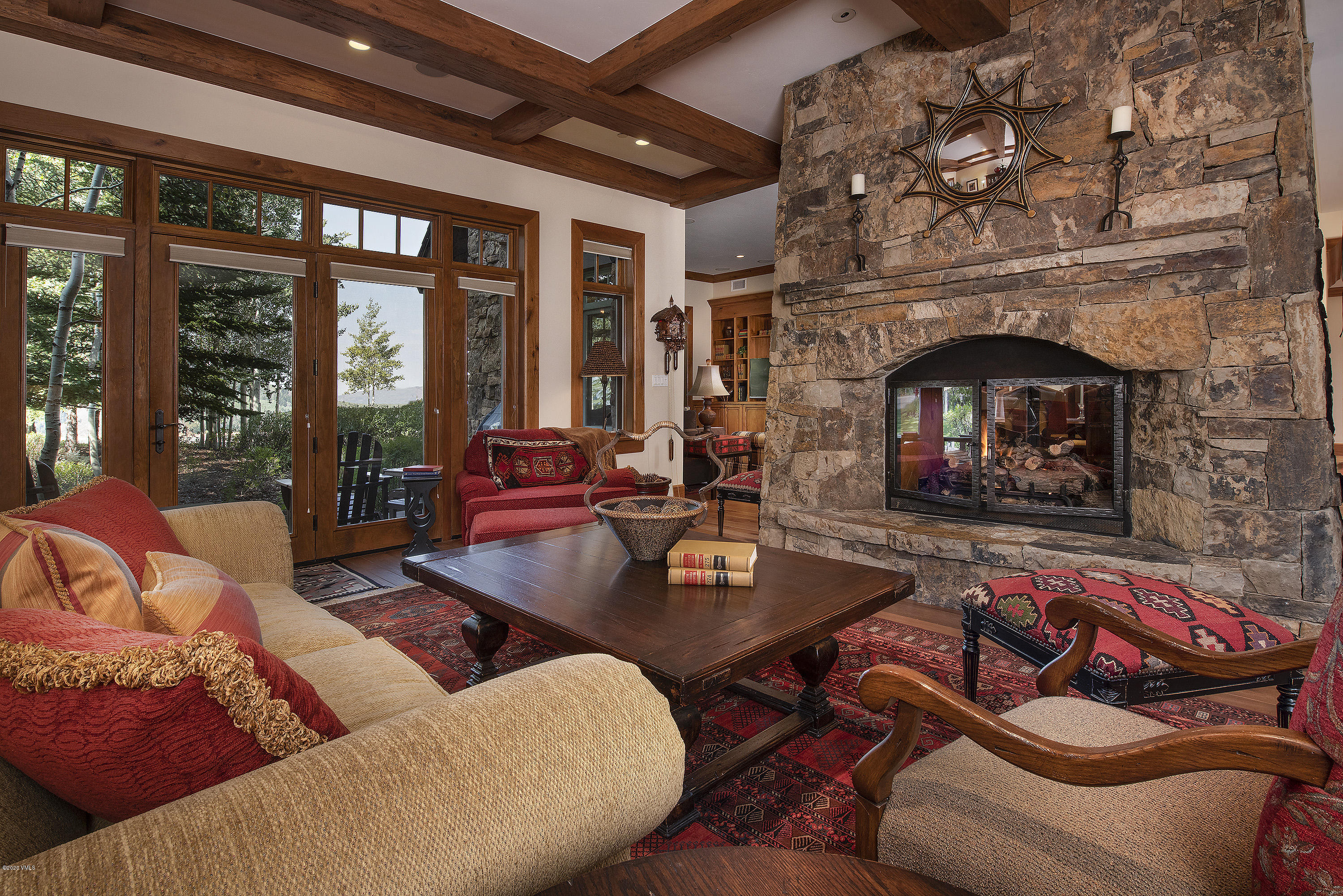 Stay home in style in this sophisticated Horizon Pass Lodge residence -- an iconic Bachelor Gulch escape where rustic meets refined.  You'll find rich wood millwork and wainscoting, rough-hewn ceiling timbers, polished granite countertops, crown molding throughout, and walls of windows framing westerly alpine views. Home is where the hearth is, and an enormous two-sided stone fireplace warms and anchors the gathering spaces. The open floor plan flows over 2500 sun-lit square feet with three spacious bedrooms and three luxurious bathrooms -- two with dual sinks. The well-appointed chef's kitchen includes a large island and a cooktop with custom butternut hood.  There are two wall ovens, two dishwashers, plenty of countertops, a bar niche, wine cooler, ice maker, and numerous cabinets offering both covered storage and open display. A comfortable den off the dining room features built-in bookcases and plenty of cabinet storage. Sliding glass doors open onto two buff flagstone patios and gardens--one off the main bedroom. This sophisticated space includes high ceilings, handsome wall coverings, attractive hardware, and ample closet space. The list of upgrades is long, all the high-end fixtures and finishes anticipated at this price point. This inspiring home in Bachelor Gulch invites homeowners to reconnect with one another and with the surrounding outdoors. Horizon Pass Lodge offers a generous amenities package. Step outside from the luxurious ski room and ski away on a lovely Bachelor Gulch groomed run. At the end of the day, ski right back in with ease for all levels. In the summer, these same trails make for incredible hiking just out the door. Soak in the year-round, heated outdoor pool or spa, take in brilliant views to the Gore Range. Lounge, game area, fitness center, front desk and concierge services meet the needs of an active mountain lifesty