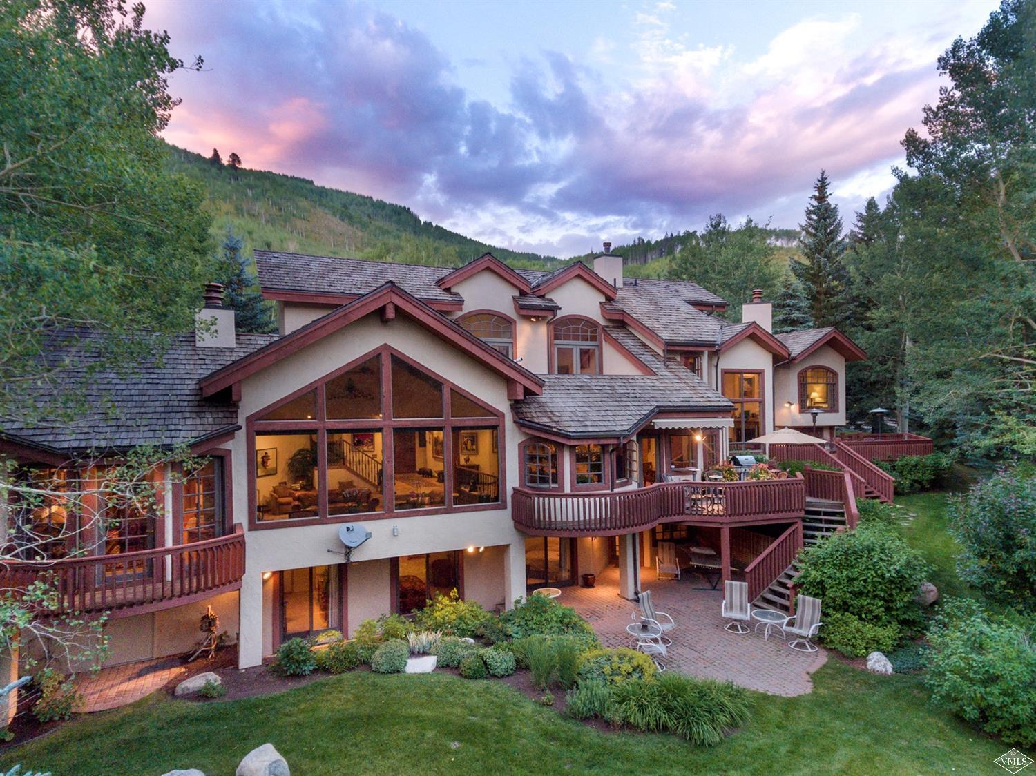 This impressive nod to a European chalet is fitted with ample windows to let in an abundance of sunlight throughout this spacious south-facing home. Expansive 7,038 SF property creates a relaxing environment to entertain generations. Bask in outstanding ski slope views from your grand living areas and multiple wooden decks. The nicely landscaped flat backyard is ideal for a game of croquet. A connected guest house creates the ability to share your home with guests while offering them privacy.