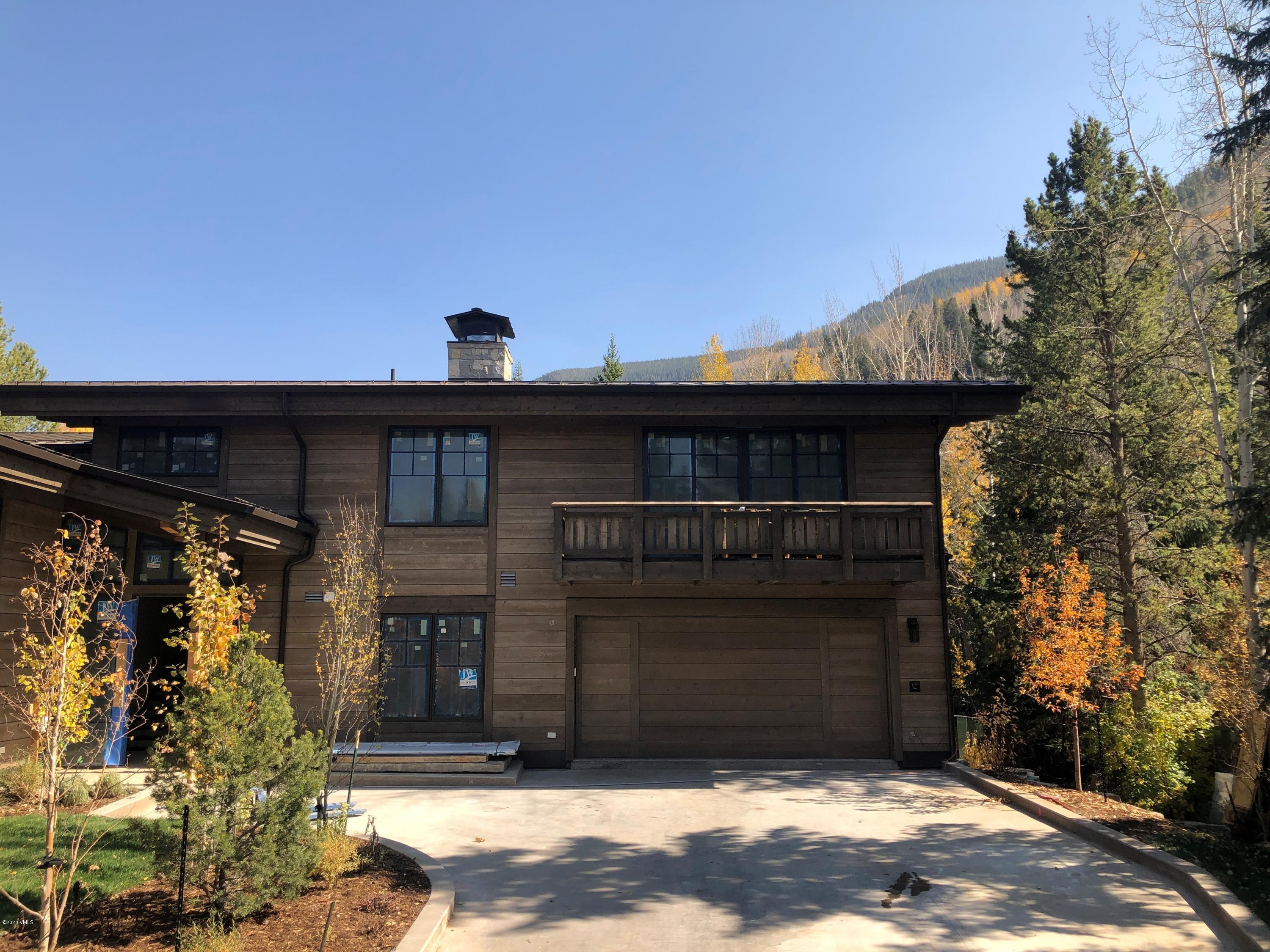 Magnificent new construction on the Vail Golf Course. This custom residence features an open floor plan, custom finishes, gourmet kitchen, radiant heat/AC  snow-melt driveway and terraces. Estimated date of completion, November 2020. Secondary side of newly constructed Duplex.