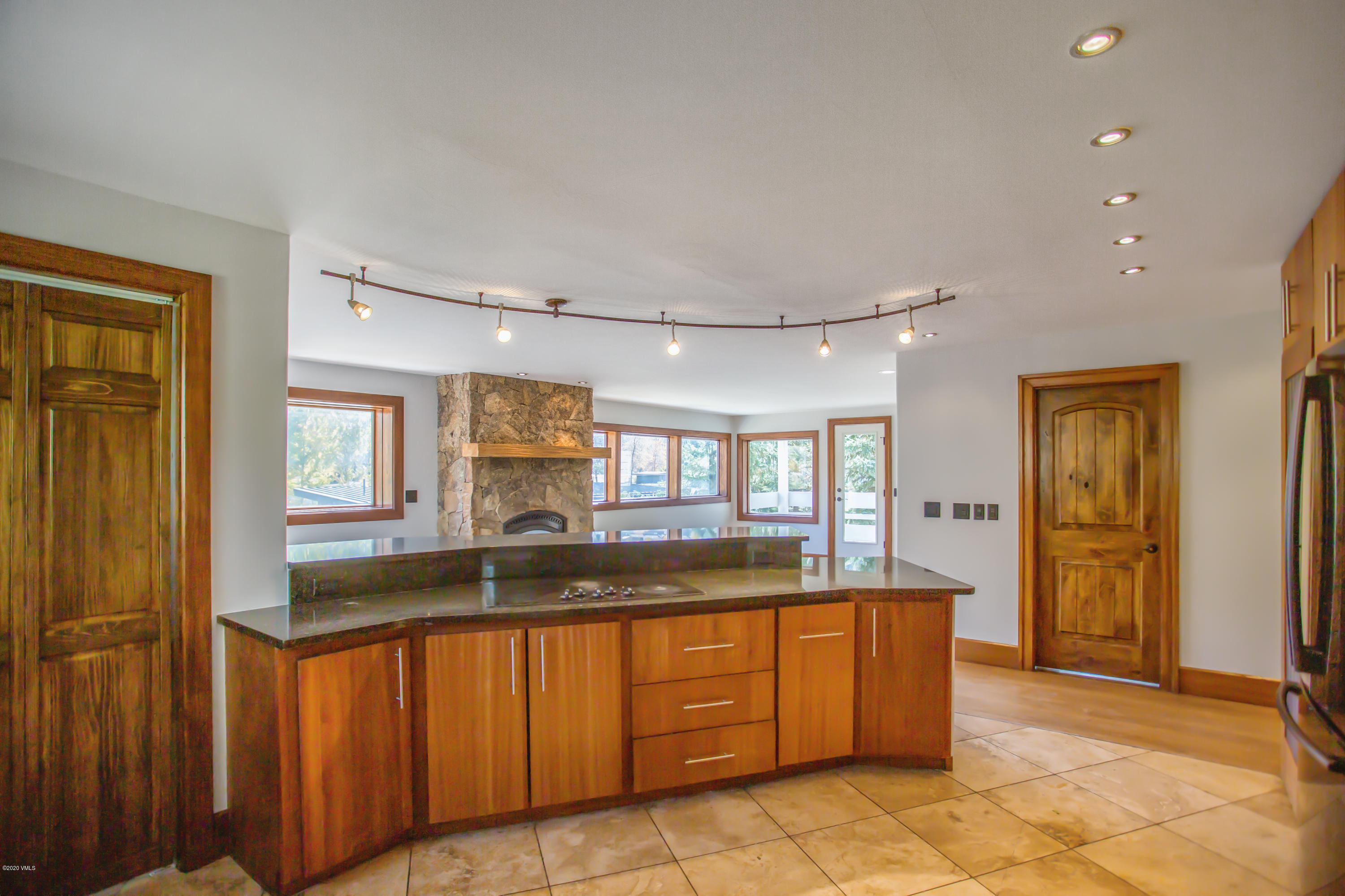This light, bright and airy retreat has windows on three sides and many updates. The gorgeous kitchen and master bath have heated floors.  The two south facing decks offer generous outdoor space and mountain views. With spacious closets and a 1 car garage, you have room for all of your toys.  Located in the heart of Eagle-Vail, the Pool, Playground, Golf Course and Community Garden are just steps from your front door.