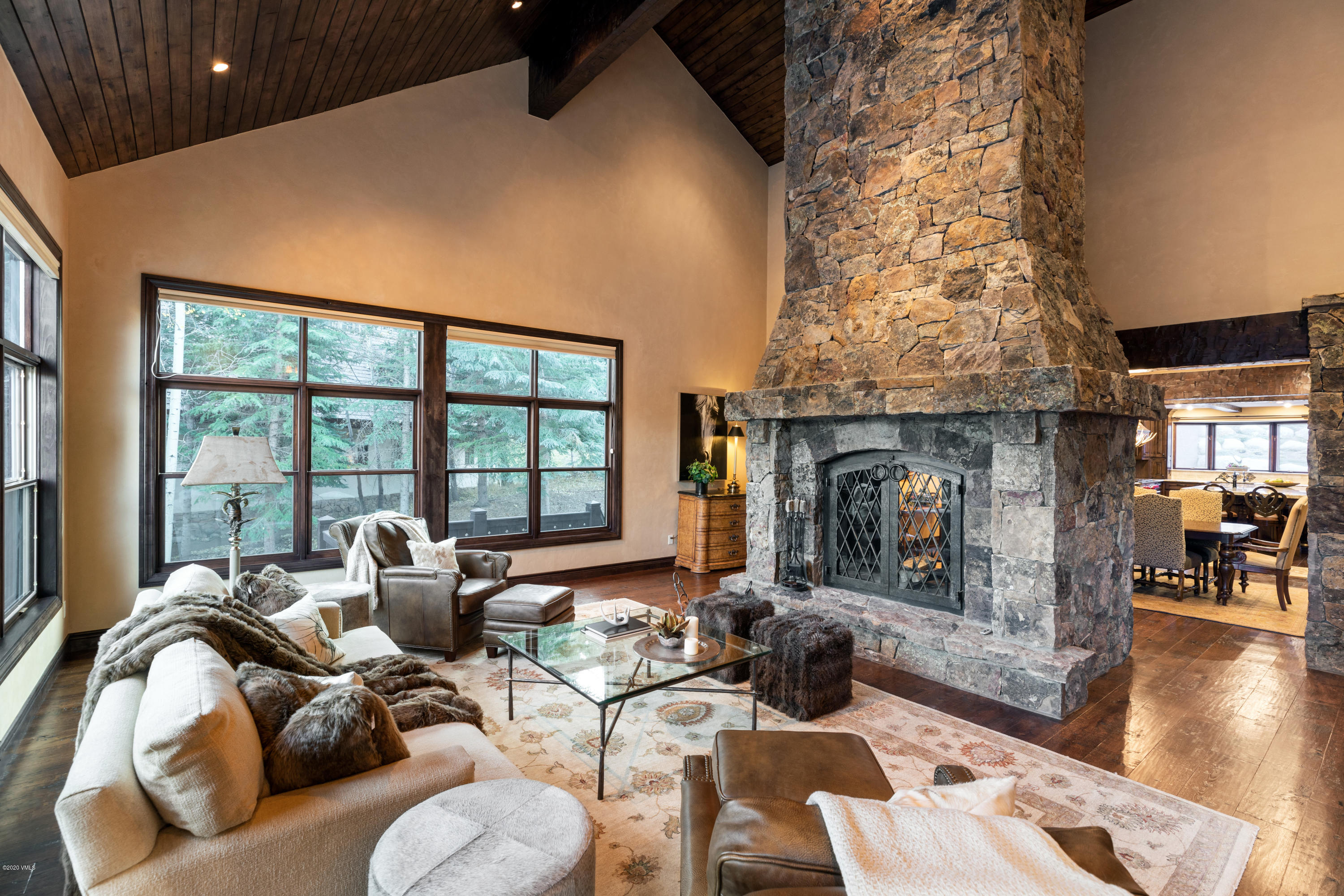 Opportunity to own a remodeled home on a private homesite within the resort with ski-in access from the McCoy Ski-Way directly to this property. Turnipseed Construction remodel with new kitchen and bathrooms; distressed flooring; professionally staged by local designer. Great room with high vaulted ceilings and a grand, wood-burning stone fireplace as the centerpiece of the main level. Spacious and comfortable floor plan with a separate caretaker's apartment. Air conditioning in the upper levels. Big, sunny back patio with fire pit and hot tub; immaculate condition; DaVinci roof. Sold partially furnished.