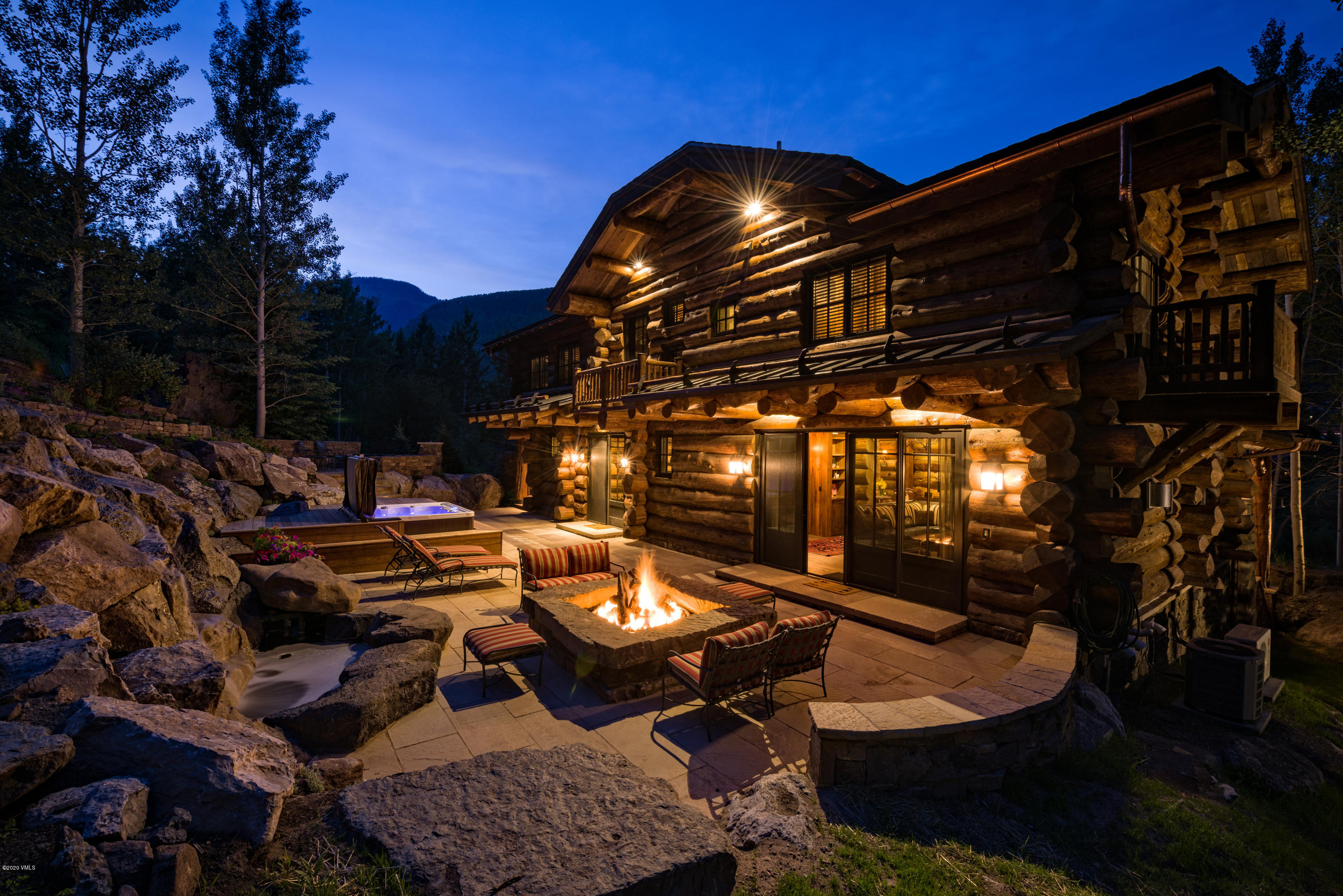Beautiful custom log gem with stunning Gore Range views, mere steps from Gore Creek, the bus to Vail Village and biking or hiking.  Nestled on almost an acre of lush private grounds rests this beautifully mastered, high end jewel with a lovely back patio and graduated sitting areas up the mountain for ultimate views and outdoor pleasure! You've found your Vail dream home at 3816  Lupine Drive.  This enchanting home with 5 bedrooms further entices with three gas fireplaces along with a private mine-shaft themed cinema for those cozy evenings. The custom log home sleeps 12 adults comfortably. The gourmet kitchen is off of a pretty great room boasting a 35 foot ceiling. Offered with custom, designer furnishings.  The back patio offers summer perennial gardens, a waterfall, a large firepit, jacuzzi and BBQ. Potential to expand or add on 4000+/- sq.ft.  This home is being offered with a turn-key successful rental business.  High-end, elegance and comfort.  Nothing like it in coveted Vail!