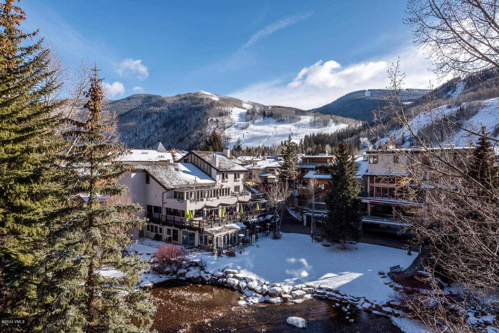 Vail Village luxury 3 Bedroom Condominium, where you can relax on 1 of 2 decks and take in the  spectacular Vail Mountain and Gore Creek views and listen to the peaceful sounds of water flowing by.  Entertaining is easy in the gourmet chef's kitchen open to the living room with gas stone fireplace and spacious dining area with custom storage and lighting.Wake up in the exceptionally large main bedroom with its own gas fireplace and large balcony overlooking the creek and mountains.  Relax after an active day of skiing in the steam shower and jacuzzi tub in the main bath. The custom closets, lighting, humidification, added storage, washer/dryer, beamed ceilings, custom Alder panelling, wide hardwood plank flooring, silk carpeting, silk window coverings define luxury.  Relax in the outdoor hot tub, heated pool, or warm up next to the fire pit after a day on the mountain.Look no further for the condo on the creek with amazing mountain views and 2 garage assigned spaces.  Manager on site.  Village Center, a very special condominium in the center of Vail to be your home in Vail.