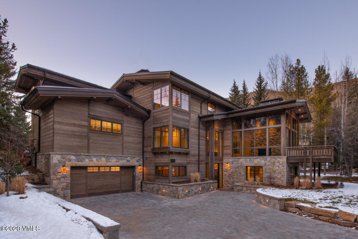 Magnificent new construction on the Vail Golf Course. This custom residence features an open floor plan, custom finishes, gourmet kitchen, radiant heat/AC  snow-melt driveway and terraces. Estimated date of completion, November 2020. Primary side of newly constructed Duplex.
