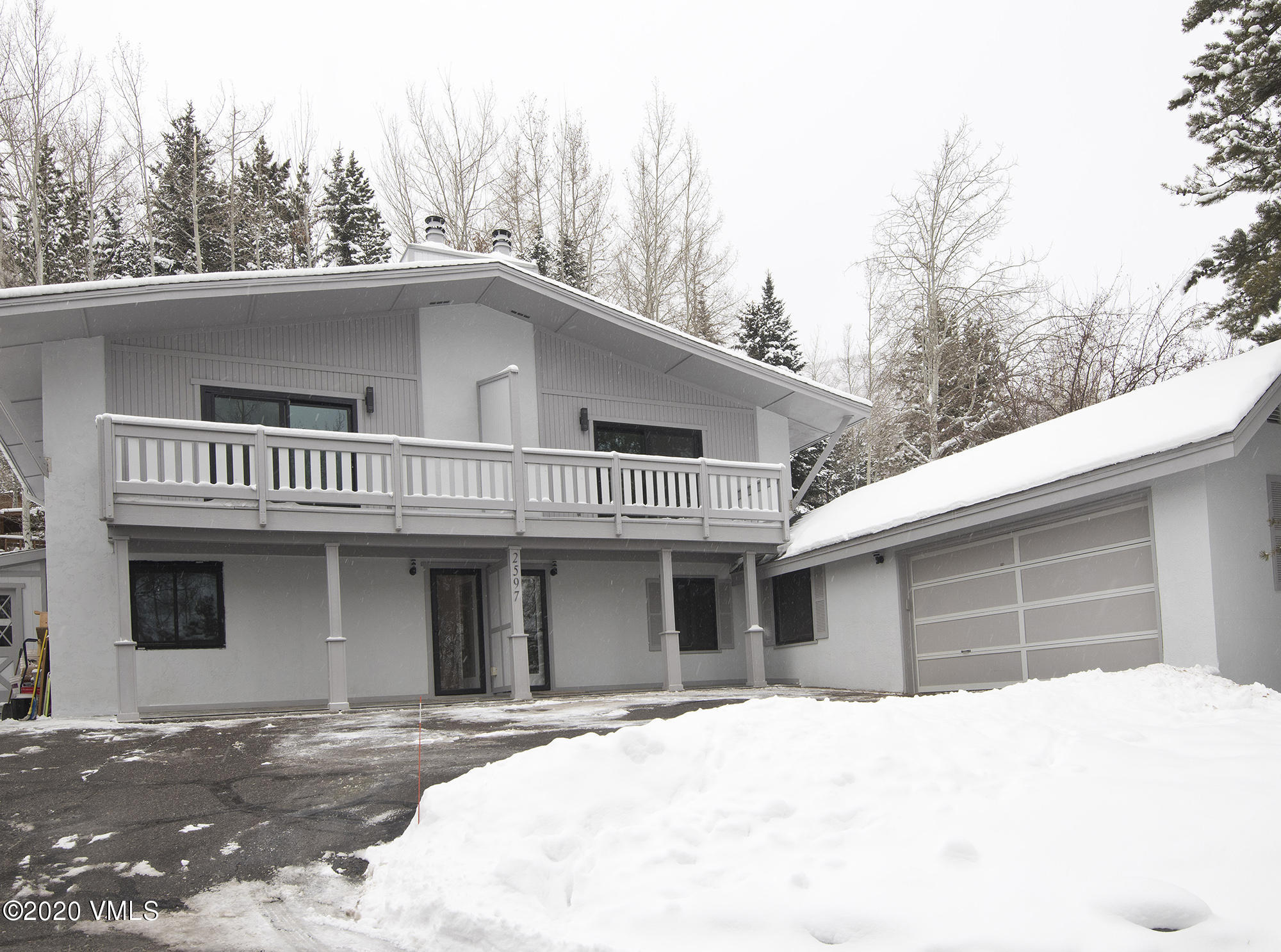Recently refurbished inside and out!  Four-bedroom + den duplex in sunny West Vail with 2-car garage!  Updated kitchen, baths and all surfaces!  2-car garage!  Alder trim, wood-burning fireplace!  Great for a local or as a second home!  Walk to the TOV free bus!