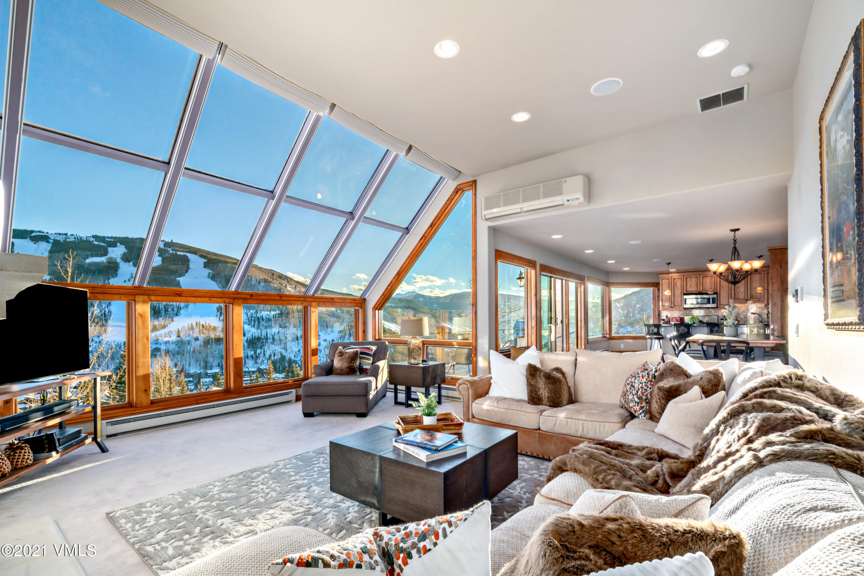 If you have been pondering whether a truly amazing and appropriately priced property would ever hit the market for you, your time has come! Experience this one of a kind ''wow'' residence with unsurpassed, panoramic views of Vail and Beaver Creek from virtually every room of this elegantly remodeled townhome. The current owner spared no expense to make sure this property met its potential.  Architectural redesign, restructuring, and expansion of this property was masterfully executed to open up the main level to make it feel like you could step across onto the ski slopes all while basking in the sunlight. This home flawlessly brings the outdoors in by replacing most of the windows with larger windows for floor to ceiling glass.  The new fireplace was relocated off of the view wall to take the views from being incredible to being unsurpassed.  Luxuriate on one of three outdoor patios, the covered heated patio with an enormous hot tub on the family room level, a heated patio off of the main level dining room with a gorgeous forged steel fire pit, and third, a rooftop deck that feels like it is on top of the world.  Apres ski in the outdoor hot tub and then come up and hang out around the outdoor fire pit.  Take a quick nap and then enjoy an elegant or casual evening with family and friends in the spacious open dining area while taking in the magical ambiance of another Vail Mountain alpen glow evening. The rooftop deck is conveniently accessible from both the main house and the master bedroom where you can wind down and watch the sunset. The master bedroom is an oasis on its own level with a bed wall that is perfectly situated for you to start the day off right by opening yours eyes to Vail's ski slopes.  Your guests won't feel they got the short-end-of-the-stick as each en suite guest room is located off the family room and have equally magnificent views.Situated only minutes from Vail, this home offers luxury and sophistication in the... highly sought after neighbor