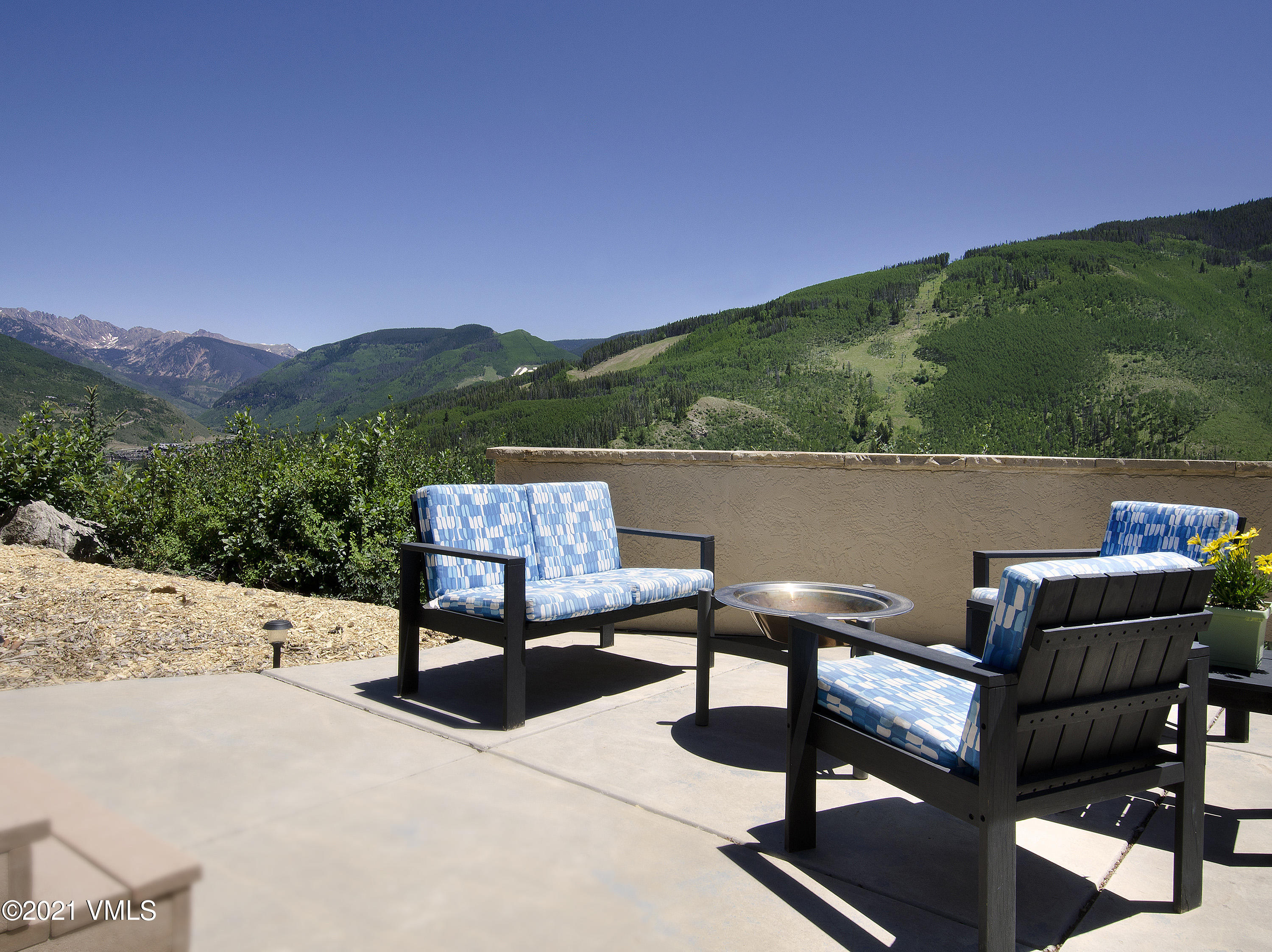 Have it all in Vail!  This 4-bedroom residence is nestled among the aspen trees yet filled with sunlight high on Aspen Ridge in Buffehr Creek in a private cul-de-sac .  This home captures phenomenal views of the Gore Range and the Vail Ski Mountain with a private patio for entertaining, family fun and taking in the Vail lifestyle.  An elevator provides easy access to the home from the garage and the lower level is perfect as a media room, game room or gym.  A new metal roof was recently installed.  Tons of storage in the home as well.  This is a good rental investment or a great opportunity to make it your own with some updating.