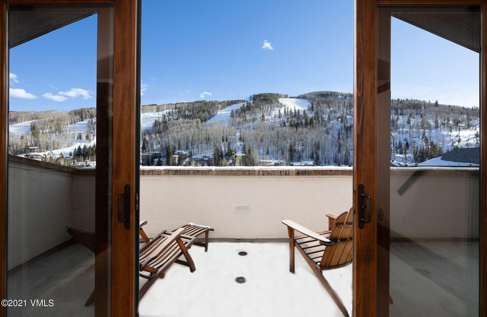 The one and only High Noon Penthouse is available for sale for the very first time. Panoramic views of Vail Mountain and the Gore Range greet you throughout the home, impressing even the most particular buyer. Wake up every morning to awe-inspiring Vail mountain slope views from the spacious primary bedroom with 12-foot vaulted ceilings, a walk-in closet, fireplace and 5-piece ensuite bath. The gourmet chef kitchen and living room continue the penthouse views from all angles, and your large 440+ square foot private deck with a heated floor not only immerses you in the surrounding mountain landscape but provides a large space for sunning, entertaining, or enjoying evening cocktails under the stars. A sought-after corner location 3-bedroom, 3-bath ensuite home with 13-foot vaulted ceilings in the great room boasts natural light throughout the desired open floor plan plus a 4th full bathroom to accommodate all hosting needs. As a Marriott penthouse owner, enjoy all amenities the resort has to offer including a heated year-round pool and spa, ski valet and ski shop, onsite restaurant and pub, an oxygen bar, full service spa and two garage parking spots. Must see in person to take in the full experience of a home such as this that is very private and quiet while having extraordinary views. A truly luxurious place to call your Vail home.