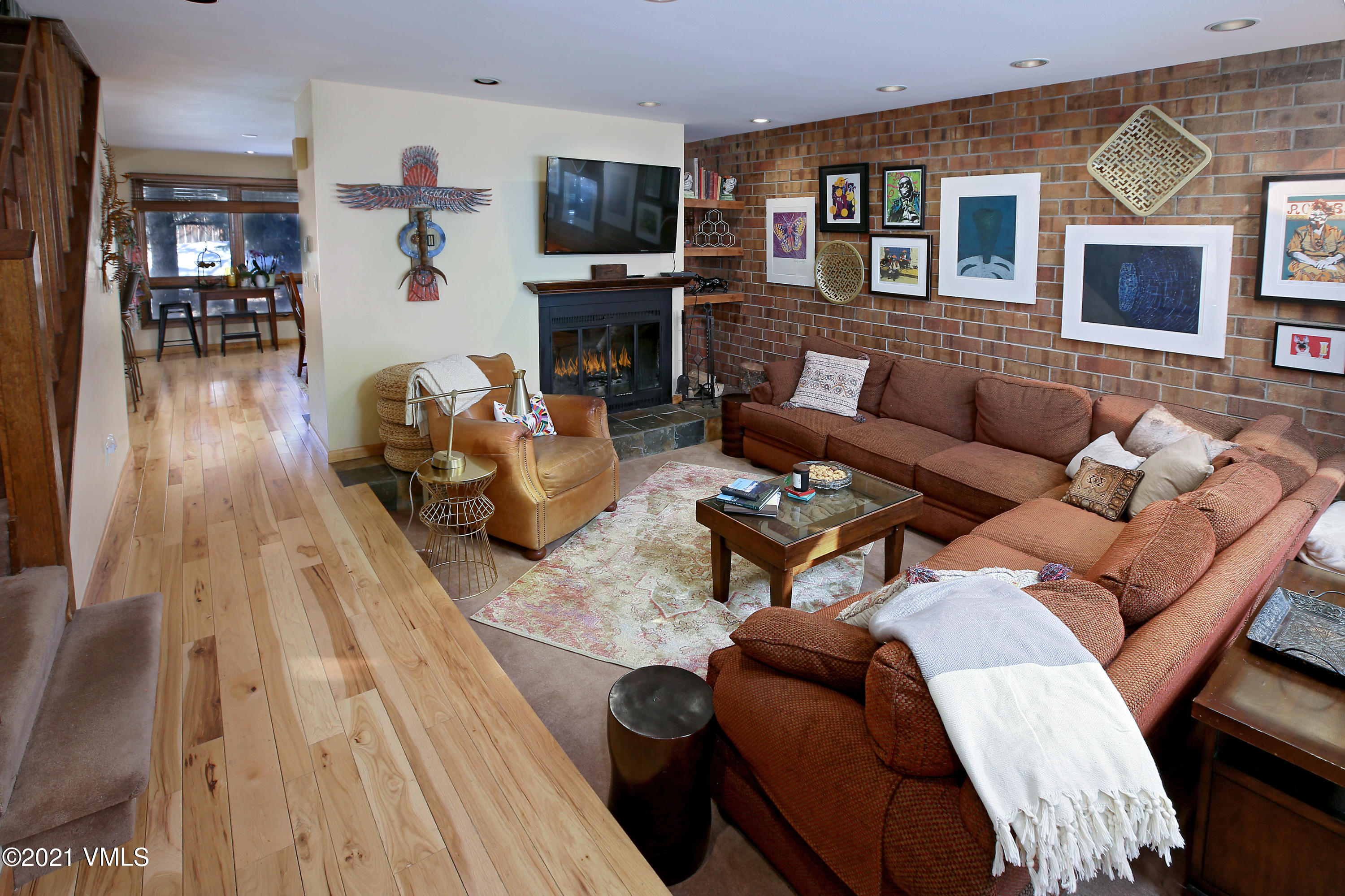 This inviting and spacious EagleVail home could be your mountain retreat. The residence offers large main-level living room with sky lights and wood-burning fireplace, which flows into a combination kitchen and dining room featuring granite countertops and hardwood flooring. Additional main-level features include powder room and an entrance to the fenced-in backyard, complete with doggie door. Upstairs provides the primary bedroom and bathroom with vaulted ceilings, and additional 2-bedrooms and bathroom. Finished basement with 6 built-in bunkbeds offer plenty of sleeping room. Ideal location between Vail and Beaver Creek resorts, across the street from EagleVail golf course and in close proximity to the ECO bus stop.