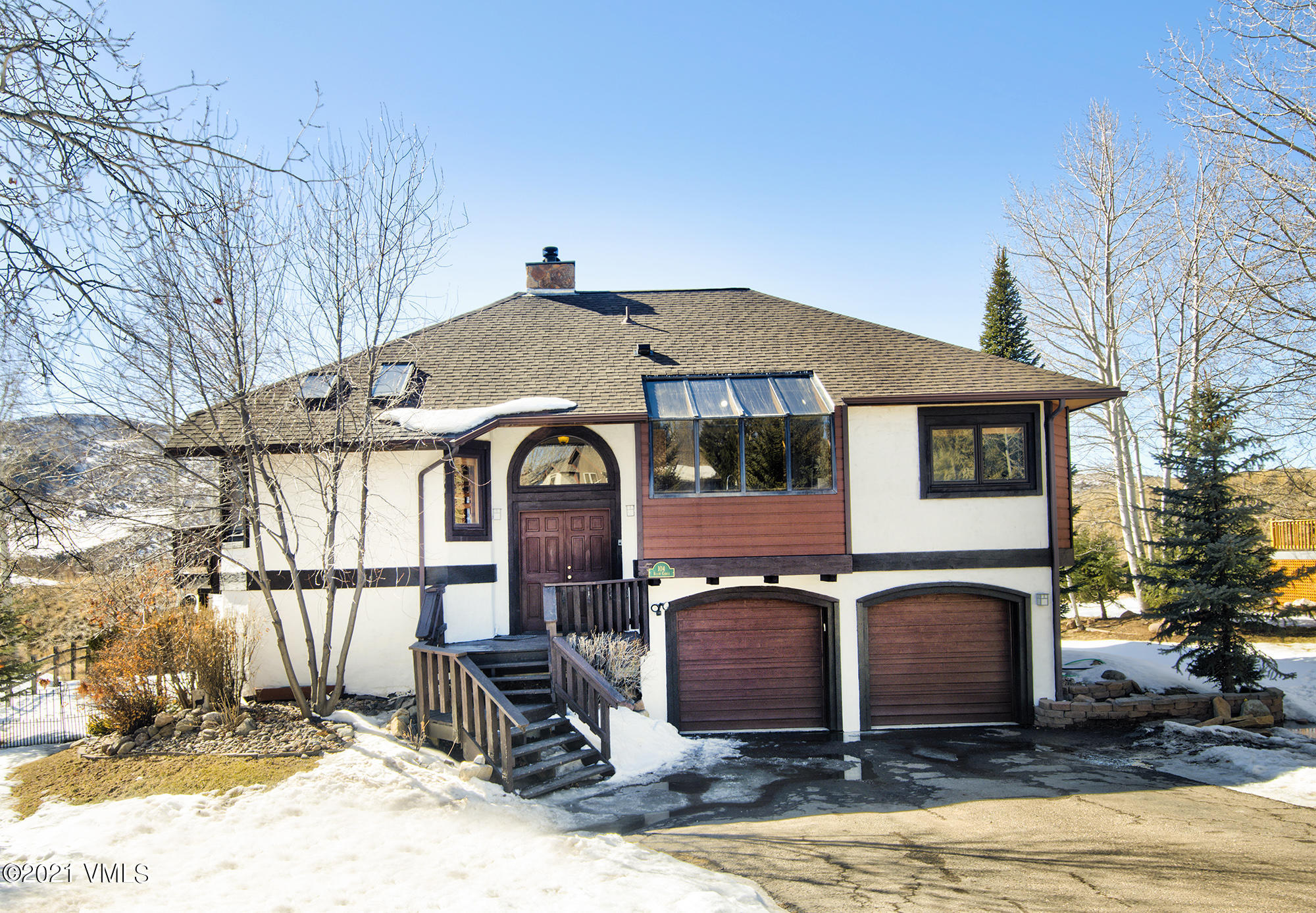 This is a unique opportunity to purchase a single-family home on a coveted lot, steps from the Homestead Court Club.  The property borders private ranch space and features a 2nd story deck with wide mountain views from Castle Peak to the Sawatch Range.The main level features a large great room and a stone chimney centerpiece with a gas fireplace on one side and a gunmetal pot-bellied wood stove on the other.  The large great room boasts high vaulted ceilings, lots of natural light, a charming loft, and convenient access to the wrap-around 2nd story deck.  The great room opens to the dining room and the adjacent updated kitchen.  The main level also features a primary bedroom and primary bathroom, a second bedroom, and a second full bathroom.  The primary bedroom opens to the back deck with a view of New York Mountain.  The primary bathroom features two sinks and an oversized double-headed shower, finished with stone, tile, and glass block.  The ground level of the home includes an oversized 2+ car garage plus workshop area, large laundry room with storage space, convenient access to the fenced-in backyard, and an appealing guest suite.  The suite features a third bedroom, well-appointed 3/4 bath, and family room (which could be converted to a 4th bedroom) that opens to the patio and fenced backyard. Do not miss this amazing opportunity to call this one-of-a-kind property home!