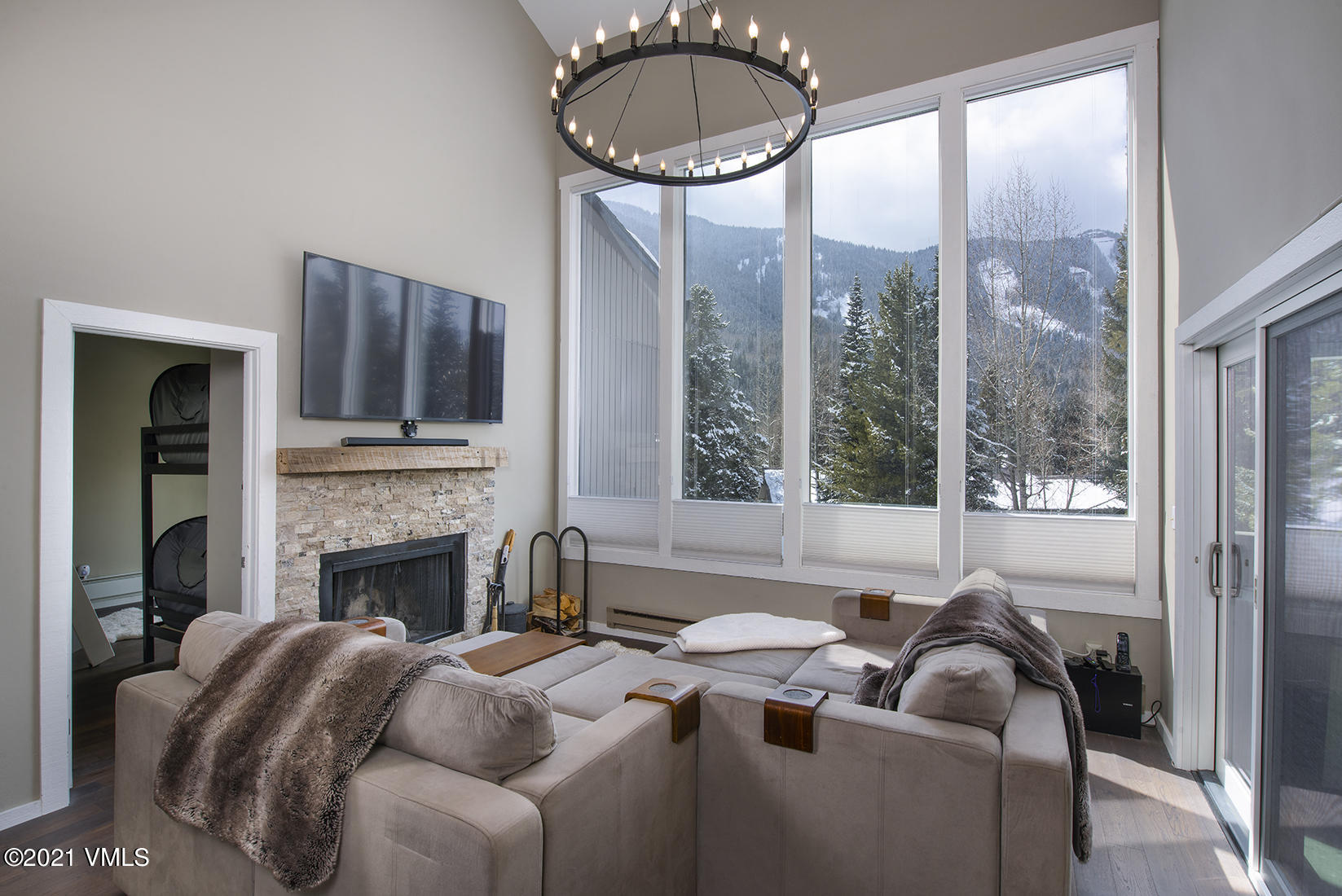 Completely remodeled, top floor, corner 2-bedroom, 2-bath plus loft residence with spectacular views of the creek and East Vail Chutes.  This condominium is light and bright with vaulted ceilings, beautiful furnishings and a wood burning fireplace.  Loft area serves as a cozy second living space with TV and couches.  Some upgrades include new sliding doors and windows, new wood flooring and carpet, all new kitchen, lighting, drywall on ceiling for energy efficiency, new paint and more.