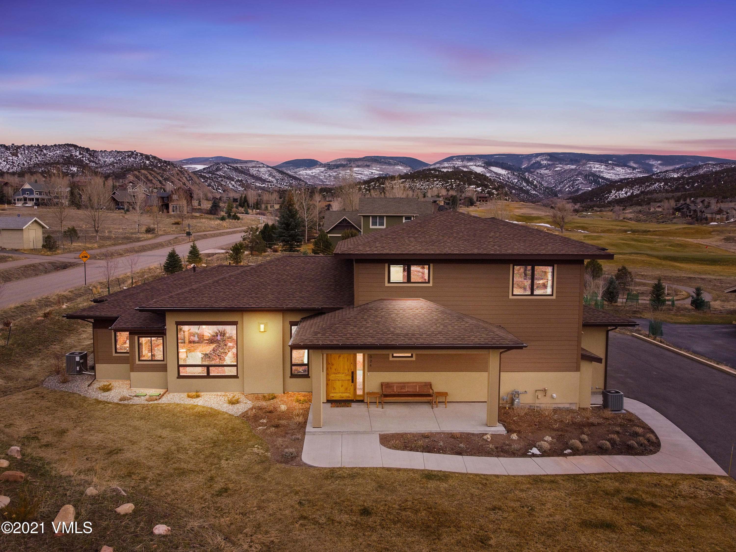 Escape to this custom luxury residence built in 2019, offering vast views of Castle Peak & Sawatch Range.  The modern setting offers sophisticated style and exquisite finishes throughout.  Home has 5 bedrooms, 5.5 bathrooms, and an open great room perfect for entertaining, vaulted 17 ft ceilings, chef's kitchen with Bosch SS gas stove, 5 gas burners & electric oven, warming drawer, beautiful L shaped granite & quartz counter tops with two sinks,  Stunning 55'' Gas Fireplace.  Bose Surround sound system throughout interior and exterior, large doorways and hallways, large covered front porch, patio slider opens to expansive South facing courtyard offering the spectacular setting of the 13th and 14th fairways of the Arnold Palmer signature design course, courtyard plumbed with natural gas ready for the grill, and 220V power for the hot tub.  Step from the courtyard into a private access to the Master with 5 piece ensuite, radiant flooring, rain shower, closet with custom built in storage, and a tiled sun room attached to master.  Two more generous bedrooms with ensuite on Main level. Second level has an additional Bedroom with en suite and expansive mountain views. Generous upstairs living area with access to outdoor patio/deck offering breathtaking views!  Upper level Lock-off 1 bed/1 bath w/ full kitchen w/eating area, living room, with access to private patio/deck with Mountain and Golf Course views.  Two 50 gallon water heaters, 2 furnaces, 2 A/C units,  2 separate garage(s) insulated,  fully finished and wired for wall heaters.  Beautiful wood and clad double pain windows throughout.  Gorgeous solid white oak floors. 10 zone sprinkler system.  All Bedrooms have ceiling fans with light and remote. Award winning schools, walking distance or short drive to country club, parks, trails, fitness centers, movie theatre, shopping and dining. Eagle Ranch is an idyllic place -to live and play!