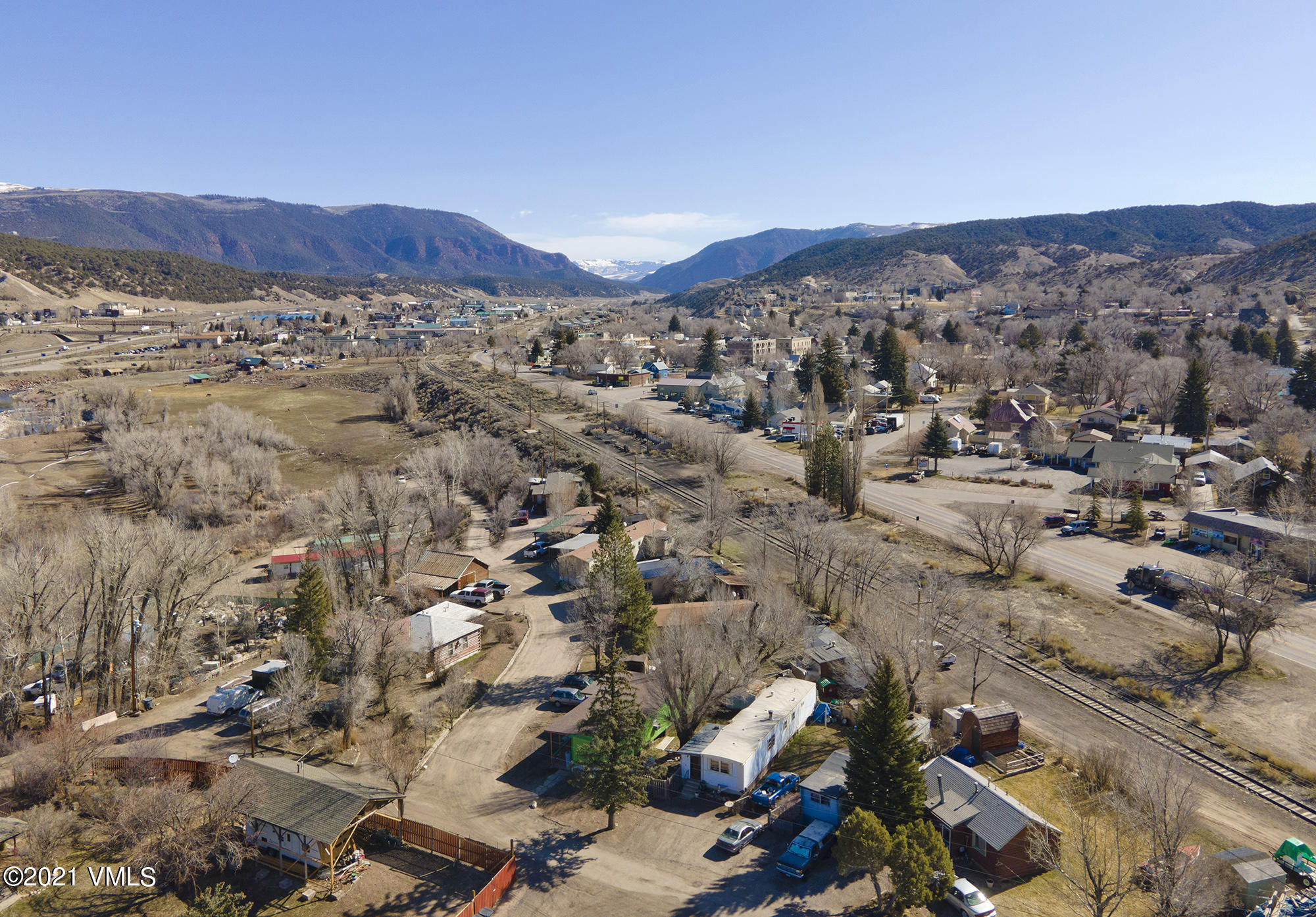 Large lot with great development potential, or just sit back and collect rents from 9 trailer lots and several storage leases.On the Eagle River.....call for additional information and  engineering of 44 units.